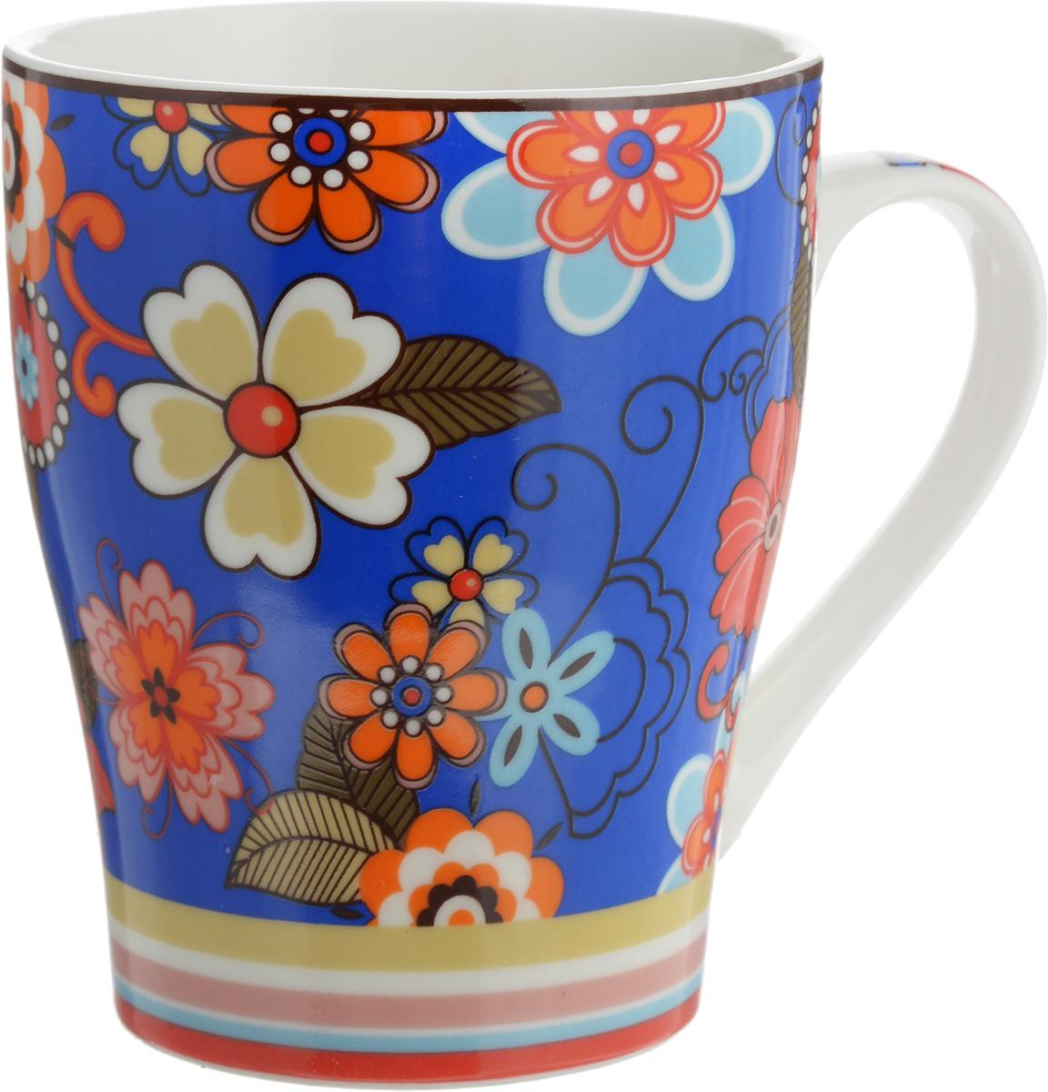Кружка Доляна Мария, цвет: синий, красный, 300 мл68/5/3Кружка Доляна Мария изготовлена из высококачественной керамики. Изделие оформлено красочным рисунком и покрыто превосходной сверкающей глазурью. Изысканная кружка прекрасно оформит стол к чаепитию и станет его неизменным атрибутом.Диаметр кружки (по верхнему краю): 8,5 см.Высота кружки: 10,5 см.