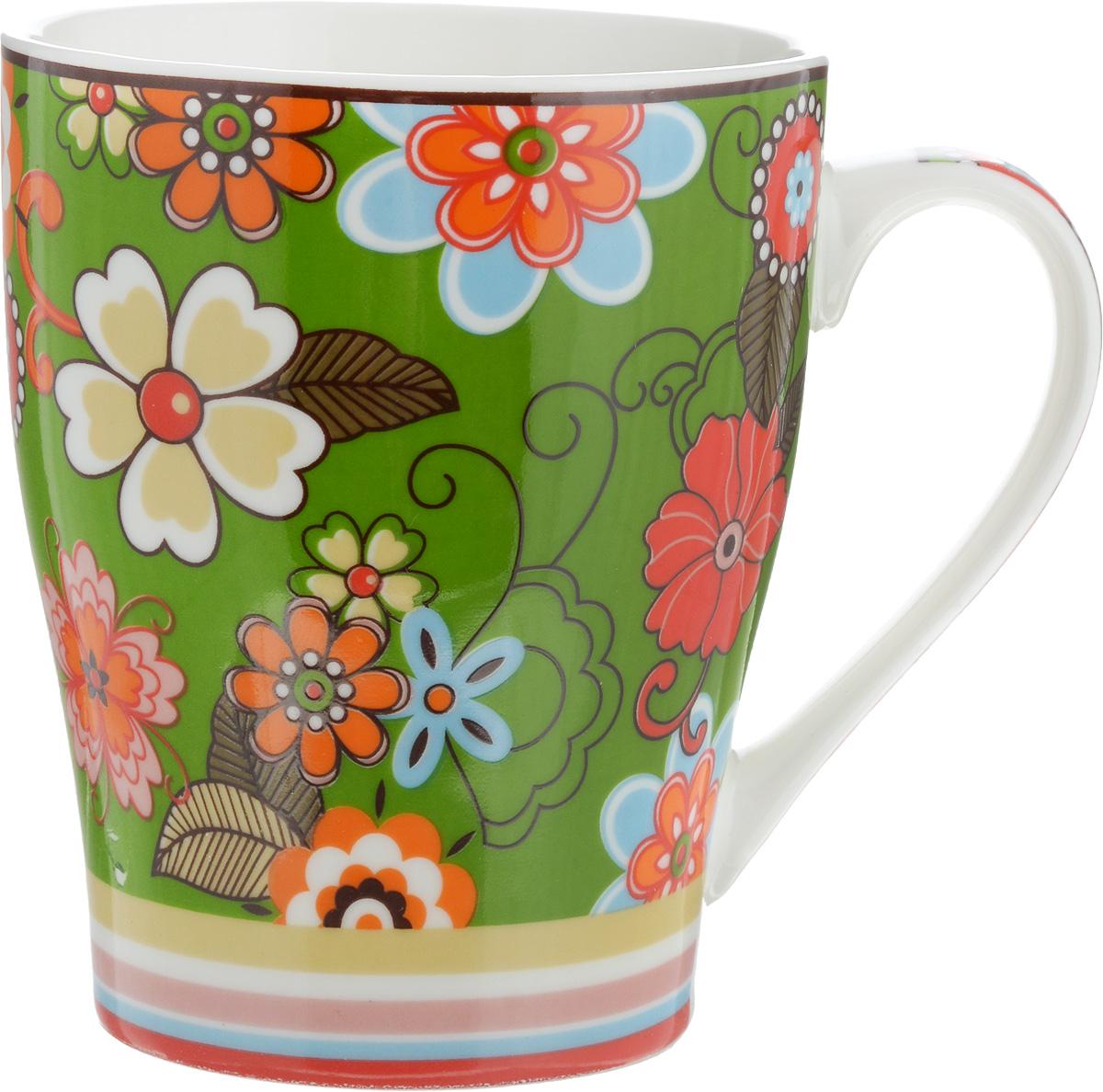 Кружка Доляна Мария, цвет: зеленый, красный, 300 мл115510Кружка Доляна Мария изготовлена из высококачественной керамики. Изделие оформлено красочным рисунком и покрыто превосходной сверкающей глазурью. Изысканная кружка прекрасно оформит стол к чаепитию и станет его неизменным атрибутом.Диаметр кружки (по верхнему краю): 8,5 см.Высота кружки: 10,5 см.