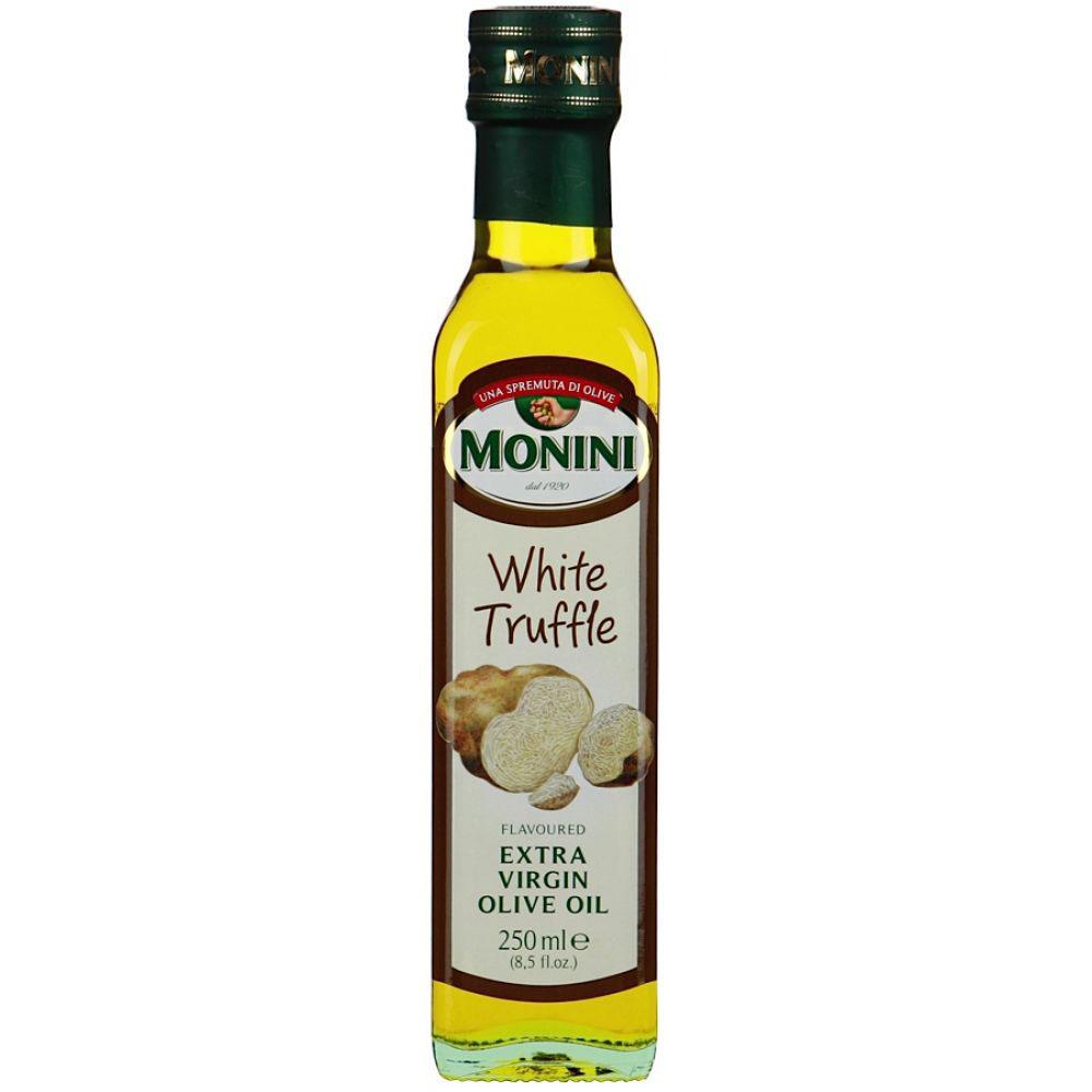 Monini масло оливковое Extra Virgin Трюфельное, 250 мл1610013/1Масло оливковое Monini Extra Virgin нерафинированное с ароматом трюфеля - итальянское оливковое масло первого холодного отжима с деликатным грибным вкусом и запахом. Такой продукт раскроет перед вами новые возможности в кулинарии, ведь всего несколько капель трюфельного масла изменит вкус привычных блюд и сделает его более дорогим и изысканным. Отлично подходит для приготовления пасты в сливочном соусе, ризотто, картофельного пюре. Им можно сбрызнуть свежеиспеченную пиццу, салат, омлет, карпаччо или стейк. Производитель не рекомендует использовать такое масло для жарки.Уважаемые клиенты! Обращаем ваше внимание на то, что упаковка может иметь несколько видов дизайна. Поставка осуществляется в зависимости от наличия на складе.