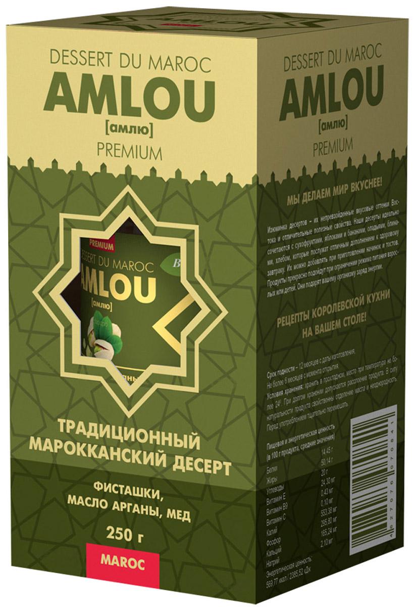 Dessert du Maroc Amlou Марокканская ореховая паста с фисташкой и маслом арганы, 250 г0120710Традиционный марокканский десерт из масла арганы, орехов и цветочного меда. Предназначен для здорового, сбалансированного и полноценного питания. Кардинальное отличие амлю от других десертов в том, что этот продукт содержит ценное масло арганы, являющегося источником витамина Е и полиненасыщенных жирных кислот Омега-6, Омега-9. Оно полностью усваивается организмом человека и способствует замедлению процесса старения клеток.МАСЛО АРГАНЫМасло арганы широко известно в мире, и его полезные свойства успешно применяют в медицине, кулинарии. Пищевое масло арганы получают прессованием семян арганового дерева. При регулярном употреблении в пищу аргановое масло нормализует показатели артериального давления и сердцебиения. Всего пара столовых ложек в течение дня препятствует развитию инфекций бактериальной и грибковой природы. Следует также отметить, что масло арганы при регулярном употреблении в несколько раз снижает вероятность возникновения и развития злокачественных опухолей, повышает защитные силы организма, а также стимулирует выведение из организма накопившихся в нем вредных веществ, используется в качестве продукта для заправки салатов и дополнительного ингредиента в приготовлении вкусных и питательных завтраков.ОРЕХИФисташки богаты витаминами группы В, в частности В6. Содержащиеся в фисташках полезные вещества сохраняют молодость и здоровье организма, защищая стенки клеток от разрушения свободными радикалами. Они также способствуют росту и обновлению клеток. Кроме этого, в фисташках присутствует витамин Е, обладающий антиоксидантными свойствами.МЕД ЦВЕТОЧНЫЙ100% натуральный из цветков апельсинового дерева. Регулярное употребление меда в пищу повышает иммунитет, делая организм более устойчивым к инфекциям.Десерты АМЛЮ очень питательны и могут использоваться как дополнение к ежедневному рациону, дающее организму энергию и даже свободно заменяющее полноценные завтрак, обед и ужин.