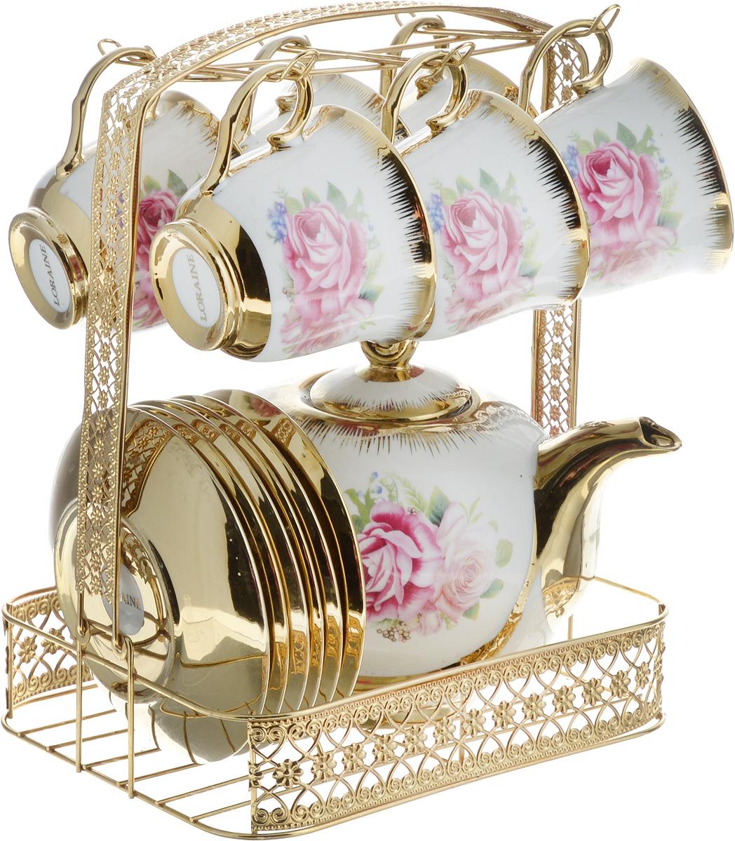 Набор чайный Loraine, на подставке, 14 предметов. 2666826554Чайный набор Loraine состоит из 6 чашек, 6 блюдец, заварочного чайника и подставки. Посуда изготовлена из качественной глазурованной керамики и оформлена изображением цветов. Блюдца и чашки имеют классическую круглую форму. Все предметы располагаются на удобной металлической подставке со съемной ручкой. Чайный набор Loraine идеально подойдет для сервировки стола и станет отличным подарком к любому празднику. Можно использовать в холодильнике и и мыть в посудомоечной машине. Объем чашки: 220 мл. Диаметр чашки (по верхнему краю): 8,7 см. Высота чашки: 7,3 см. Диаметр блюдца: 13,5 см. Высота блюдца: 2 см.Объем чайника: 950 мл. Размер чайника (с учетом ручки, носика и крышки): 21 х 12,5 х 15,5 см. Размер подставки (с учетом ручки): 21 х 18 х 26,5 см.