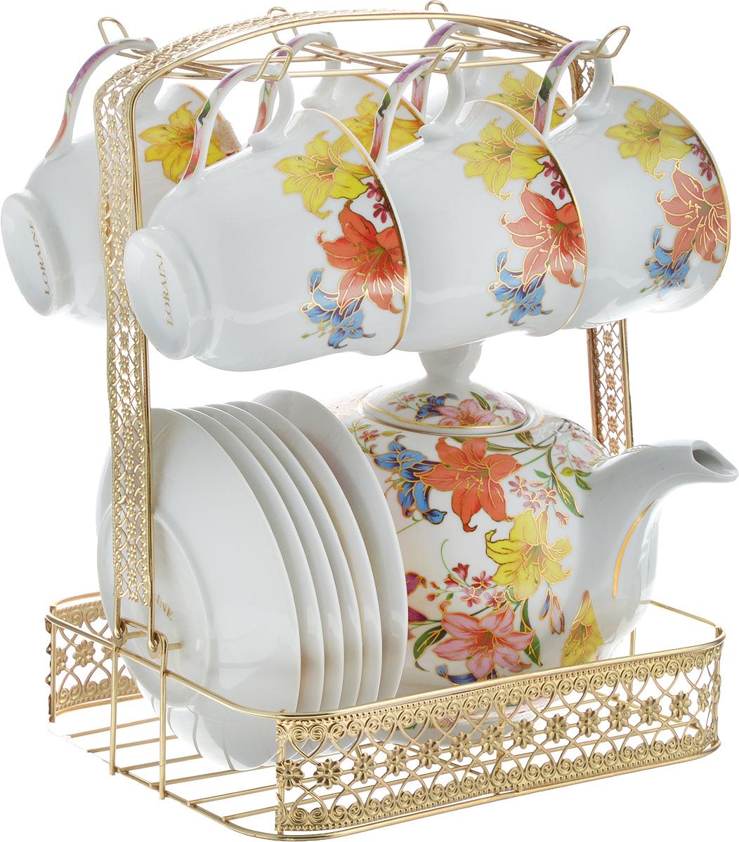 Набор чайный Loraine, на подставке, 14 предметов. 26666115510Чайный набор Loraine состоит из 6 чашек, 6 блюдец, заварочного чайника и подставки. Посуда изготовлена из качественной глазурованной керамики и оформлена изображением цветов. Блюдца и чашки имеют классическую круглую форму. Все предметы располагаются на удобной металлической подставке со съемной ручкой. Чайный набор Loraine идеально подойдет для сервировки стола и станет отличным подарком к любому празднику. Можно использовать в холодильнике и и мыть в посудомоечной машине. Объем чашки: 220 мл. Диаметр чашки (по верхнему краю): 8,7 см. Высота чашки: 7,3 см. Диаметр блюдца: 13,5 см. Высота блюдца: 2 см.Объем чайника: 950 мл. Размер чайника (с учетом ручки, носика и крышки): 21 х 12,5 х 15,5 см. Размер подставки (с учетом ручки): 21 х 18 х 26,5 см.