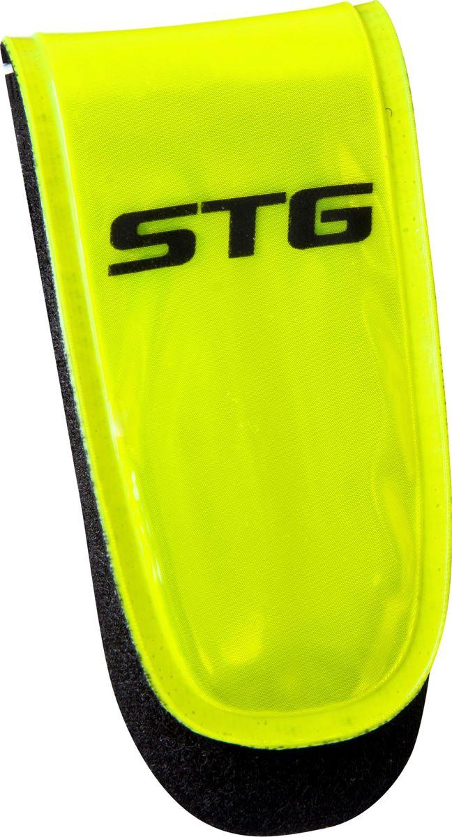 Клипса светоотражающая STG 49011, на липучкеХ82804Универсальный светоотражатель-клипса STG 49011 можно установить на велосипед, рюкзак, или надеть на руку или ногу. В ее составе ткань, пластик и метал. Клипса на липучке с тремя красными диодами поможет обезопасить вас в темное время суток и сделает более заметным на дороге.