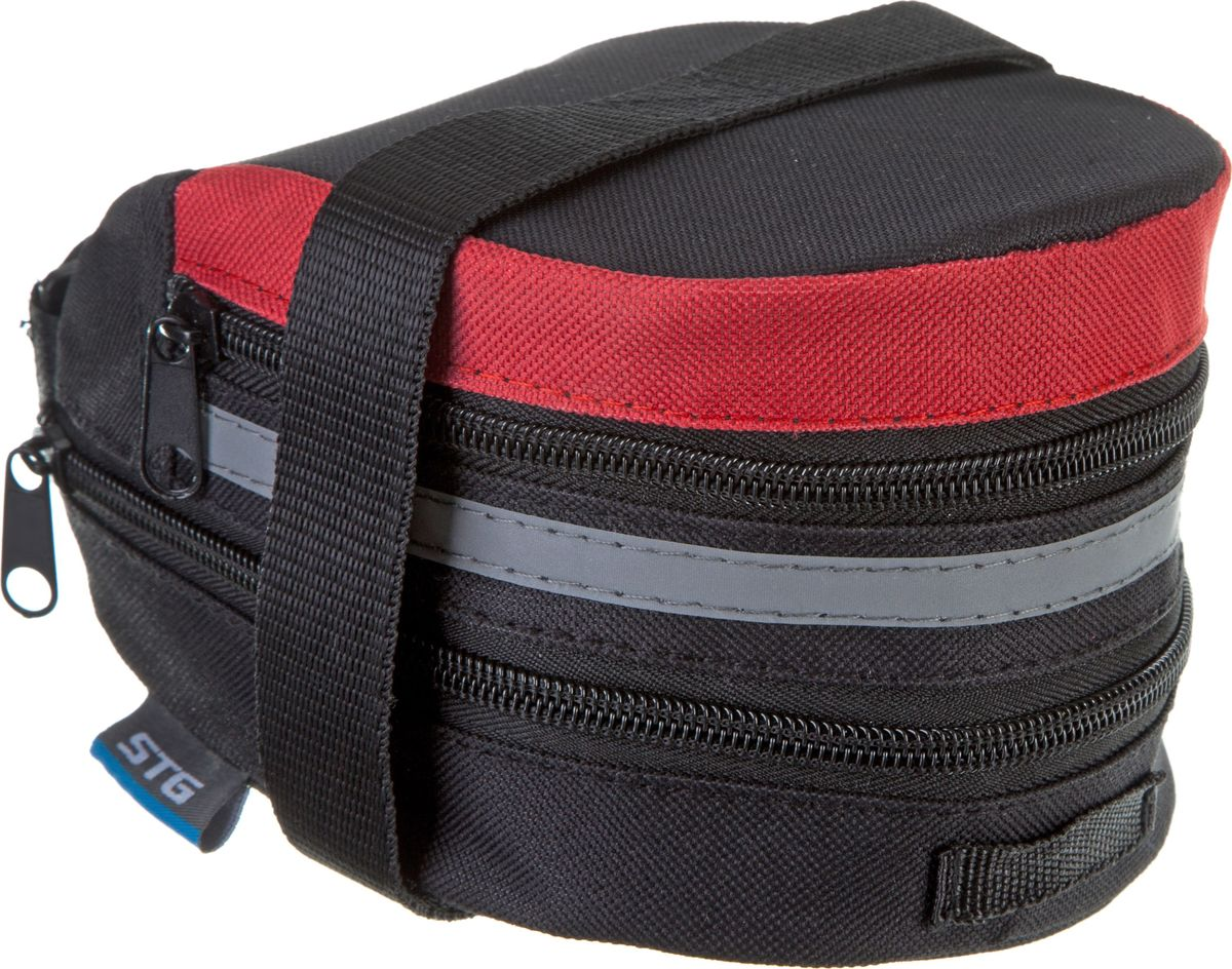 Велосумка STG 13014, под седло, цвет: черный, красныйZ90 blackКомпактная и вместительная сумка для крепления под седло не доставит вам дискомфорта. Вы сможете перевозить небольшой набор инструментов или личные вещи во время велопрогулок. Сумка оборудована светоотражающим элементом.