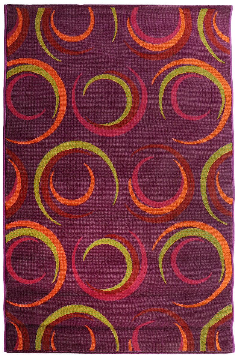 Коврик прикроватный Oriental Weavers Дaззл, цвет: фиолетовый, 100 х 150 см. 15058FS-91909Яркая циновка с мягким и упругим ворсом - неповторимый элемент для гостиных и детских комнат. Оригинальный ковер от известной египетской фабрики Oriental Weavers подойдет для современных и классических интерьеров.