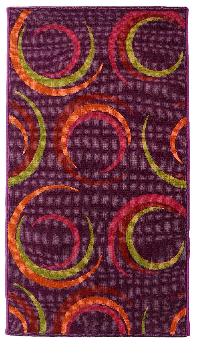 Коврик прикроватный Oriental Weavers Дaззл, цвет: фиолетовый, 67 х 120 см. 15038FS-91909Яркая циновка с мягким и упругим ворсом - неповторимый элемент для гостиных и детских комнат. Оригинальный ковер от известной египетской фабрики Oriental Weavers подойдет для современных и классических интерьеров.