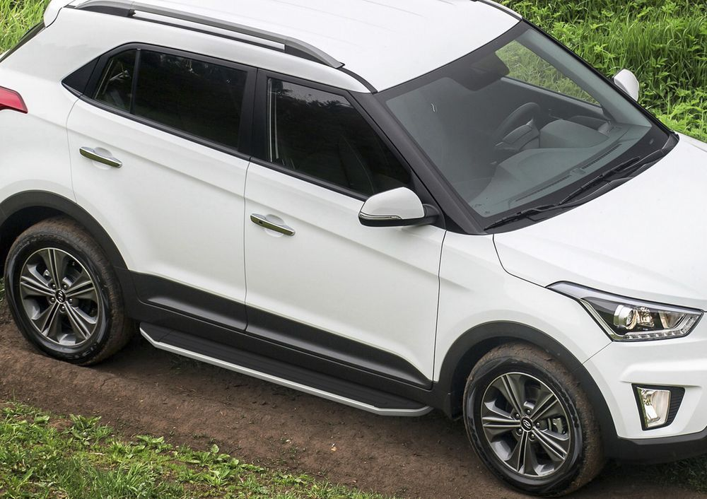Пороги Rival, для Hyundai Creta 2016-, 173 см, 2 шт. A173ALP.2310.1A173ALP.2310.1Надежные пороги Rival обеспечивают удобство посадки в автомобиль водителю и пассажирам(в особенности детям), дополняют экстерьер автомобиля, придавая ему стильность и индивидуальность. Основное преимущество порогов Rival - наличие силовых кронштейнов, которые позволяют порогу выдерживать динамическую нагрузку до 300 кг, без повреждений конструкции.- Алюминиевая основа не поддается коррозии, обеспечивает легкость и прочность.- Накладка порога из прорезиненного пластика (возможен выбор дизайна) препятствует скольжению.- Препятствует повреждению боковых поверхностей автомобиля.- Установка в штатные места крепления не требует сверления и дополнительной доработки автомобиля.- Сохранение дорожного просвета (клиренса).-Возможность регулировки порогов при установке на автомобиле.-В комплекте стальной крепеж (толщина 5 мм) и инструкция по установке.Совместимость с дополнительным оборудованием и аксессуарами Rival и с большинством оригинальных аксессуаров.