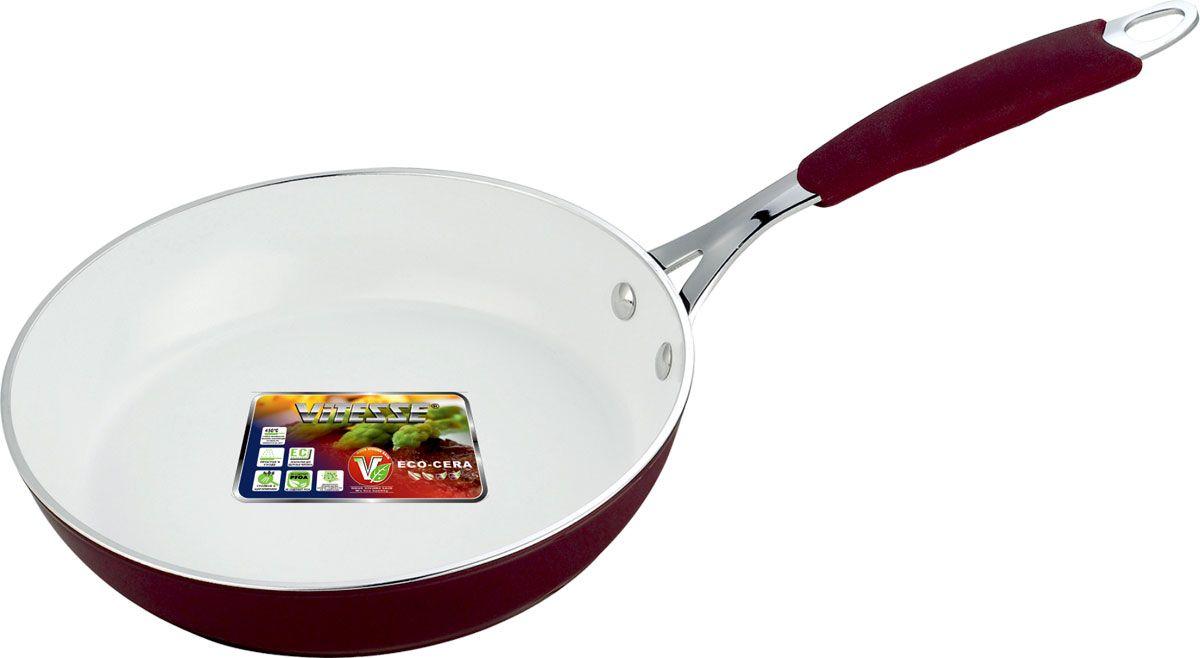 Сковорода Vitesse, с керамическим покрытием, цвет: бордо, белый. Диаметр 20 см. VS-2230VS-2230-redСковорода Vitesse изготовлена из высококачественного кованого алюминия, что обеспечивает равномерное нагревание и быстрое доведение блюд до готовности. Внешнее цветное термостойкое покрытие обеспечивает легкую чистку. Внутреннее керамическое покрытие Eco-Cera белого цвета абсолютно безопасно для здоровья человека и окружающей среды, так как не содержит вредной примеси PFOA и имеет низкое содержание CO в выбросах при производстве. Керамическое покрытие обладает высокой прочностью, что позволяет готовить при температуре до 450°С и использовать металлические лопатки. Кроме того, с таким покрытием пища не пригорает и не прилипает к стенкам. Готовить можно с минимальным количеством подсолнечного масла. Сковорода быстро разогревается, распределяя тепло по всей поверхности, что позволяет готовить в энергосберегающем режиме, значительно сокращая время, проведенное у плиты.Сковорода оснащена термостойкой не нагревающейся ручкой удобной формы, выполненной из нержавеющей стали с силиконовым покрытием. Можно использовать на всех видах плит, включая индукционные. Можно мыть в посудомоечной машине.Диаметр по верхнему краю: 20 см.Высота стенки: 4,5 см.