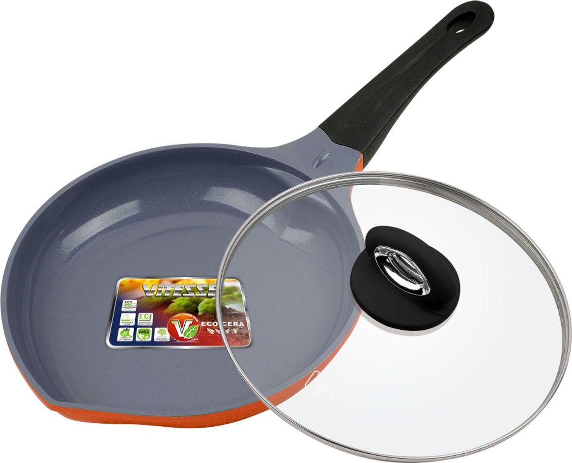 Сковорода Vitesse Peach с крышкой, с керамическим покрытием, цвет: оранжевый. Диаметр 24 смFS-91909Сковорода Vitesse Peach изготовлена из высококачественного литого алюминия. Внешнее цветное термостойкое покрытие с рельефом в виде сот обеспечивает легкую чистку. Внутреннее керамическое покрытие Eco-Cera абсолютно безопасно для здоровья человека и окружающей среды, так как не содержит вредной примеси PFOA и имеет низкое содержание CO в выбросах при производстве. Керамическое покрытие обладает высокой прочностью, что позволяет готовить при температуре до 450°С и использовать металлические лопатки. Кроме того, с таким покрытием пища не пригорает и не прилипает к стенкам. Готовить можно с минимальным количеством подсолнечного масла. Дно оснащено антидеформационным диском. Сковорода быстро разогревается, распределяя тепло по всей поверхности, что позволяет готовить в энергосберегающем режиме, значительно сокращая время, проведенное у плиты.Сковорода оснащена термостойкой ненагревающейся ручкой удобной формы, выполненной из бакелита с эффектом Soft-Touch. Имеется носик для слива жидкости. Крышка выполнена из термостойкого стекла с ободком из нержавеющей стали и пароотводом.Можно использовать на газовых, электрических, стеклокерамических, галогенных, индукционных плитах. Можно мыть в посудомоечной машине.Диаметр: 24 см.Высота стенки: 5 см.Толщина стенки: 2,8 мм.Толщина дна: 6 мм.Длина ручки: 19 см.