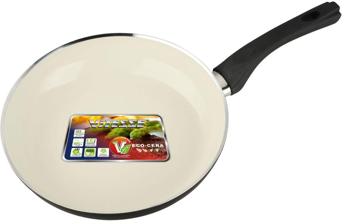 Сковорода Vitesse Black-and-White, с керамическим покрытием, цвет: черный, белый. Диаметр 26 смFS-91909Сковорода Vitesse Black-and-White изготовлена из высококачественного алюминия с внутренним керамическим покрытием премиум-класса Eco-Cera. Благодаря керамическому покрытию пища не пригорает и не прилипает к поверхности сковороды, что позволяет готовить с минимальным количеством масла. Кроме того, такое покрытие абсолютно безопасно для здоровья человека, так как не содержит вредной примеси PFOA. Покрытие стойко к высоким температурам (до 450°С), устойчиво к царапинам.С внешней стороны сковорода имеет элегантное матовое термостойкое покрытие черного цвета. Дно сковороды снабжено антидеформационным индукционным диском. Сковорода быстро разогревается, распределяя тепло по всей поверхности, что позволяет готовить в энергосберегающем режиме, значительно сокращая время, проведенное у плиты.Сковорода оснащена прочной ненагревающейся бакелитовой ручкой с покрытием Soft-Touch. Сковорода пригодна для использования на всех типах плит, включая индукционные. Подходит для чистки в посудомоечной машине. Характеристики:Материал: алюминий, бакелит. Цвет: черный, белый. Внутренний диаметр сковороды: 26 см. Высота стенки сковороды: 5,5 см. Толщина стенки: 2,7 мм. Толщина дна: 5 мм. Длина ручки: 18,5 см. Диаметр индукционного диска: 17,5 см.Кухонная посуда марки Vitesse из нержавеющей стали 18/10 предоставит вам все необходимое для получения удовольствия от приготовления пищи и принесет радость от его результатов. Посуда Vitesse обладает выдающимися функциональными свойствами. Легкие в уходе кастрюли и сковородки имеют плотно закрывающиеся крышки, которые дают возможность готовить с малым количеством воды и экономией энергии, и идеально подходят для всех видов плит: газовых, электрических, стеклокерамических и индукционных. Конструкция дна посуды гарантирует быстрое поглощение тепла, его равномерное распределение и сохранение. Великолепно отполированная поверхность, а также многочислен