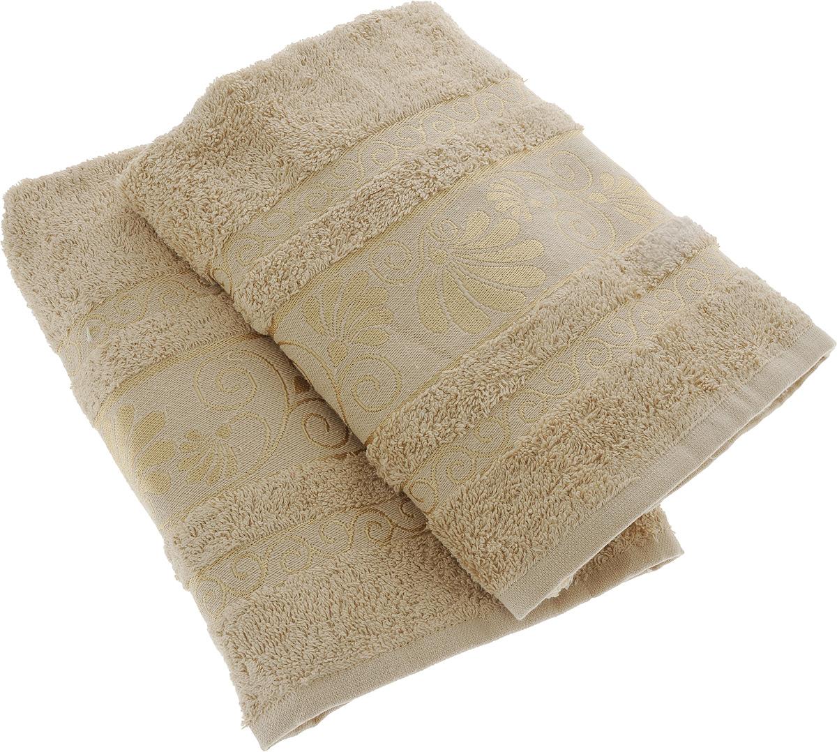 Набор махровых полотенец Aisha Home Textile Цветы, цвет: бежевый, 50 х 90 см, 2 шт531-105Набор Aisha Home Textile Цветы состоит из двух махровых полотенец, выполненных из 100% хлопка. Изделия отличаются мягкостью и гигроскопичностью, быстро сохнут, при соблюдении рекомендаций по уходу не линяют и не теряют форму даже после многократных стирок. Линейка Цветы создавалась специально для женщин. Полотенца декорированы бордюром с растительным мотивом и выполнены в нежнейших тонах. Махровые полотенца Цветы станут прекрасным дополнением дизайна ванной комнаты и подарят мягкость и уют своей хозяйке. Полотенца упакованы в подарочную коробку.