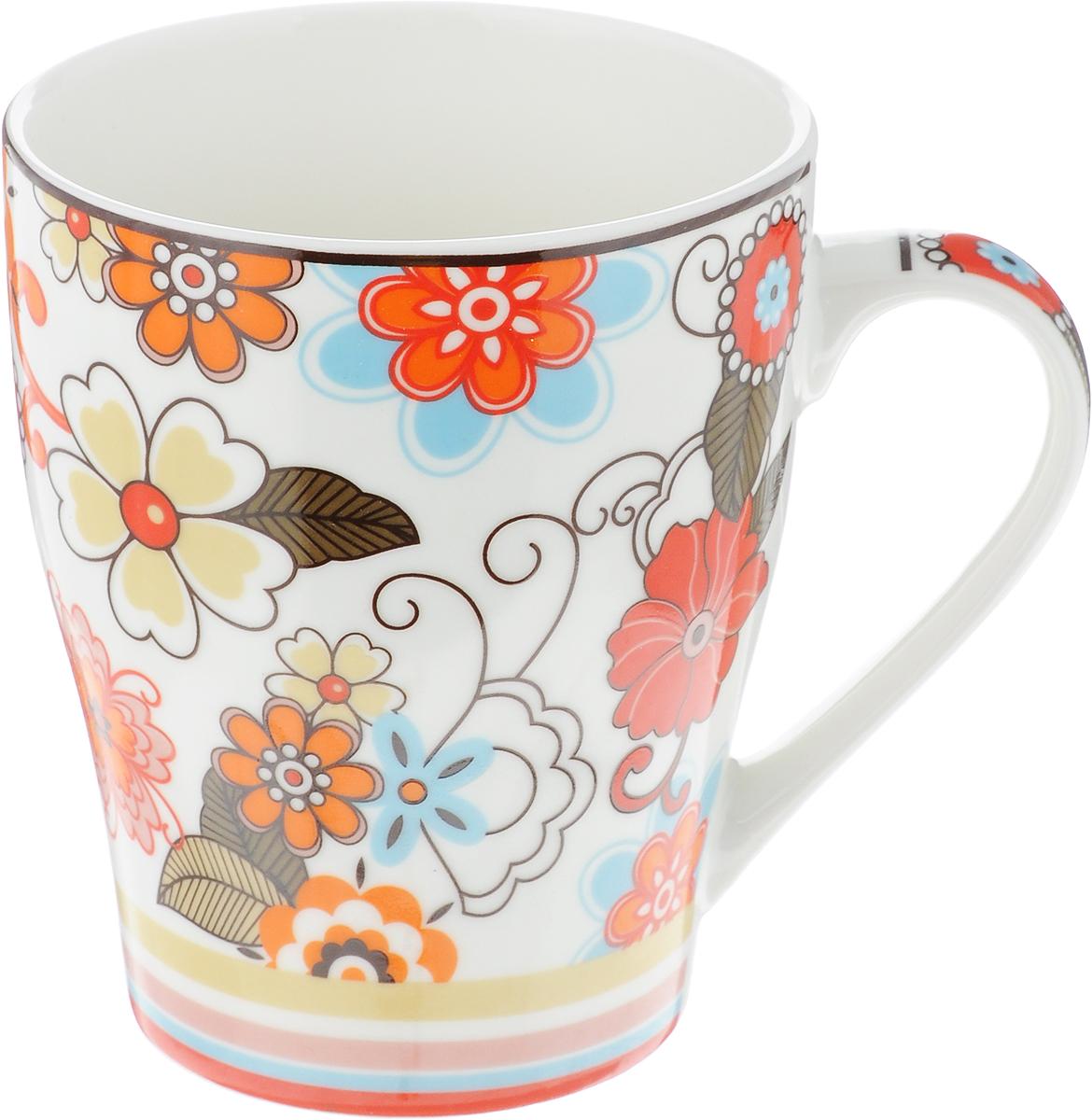 Кружка Доляна Мария, цвет: белый, оранжевый, 300 мл391602Кружка Доляна Мария изготовлена из высококачественной керамики. Изделие оформлено красочным рисунком и покрыто превосходной сверкающей глазурью. Изысканная кружка прекрасно оформит стол к чаепитию и станет его неизменным атрибутом.Диаметр кружки (по верхнему краю): 8,5 см.Высота кружки: 10,5 см.