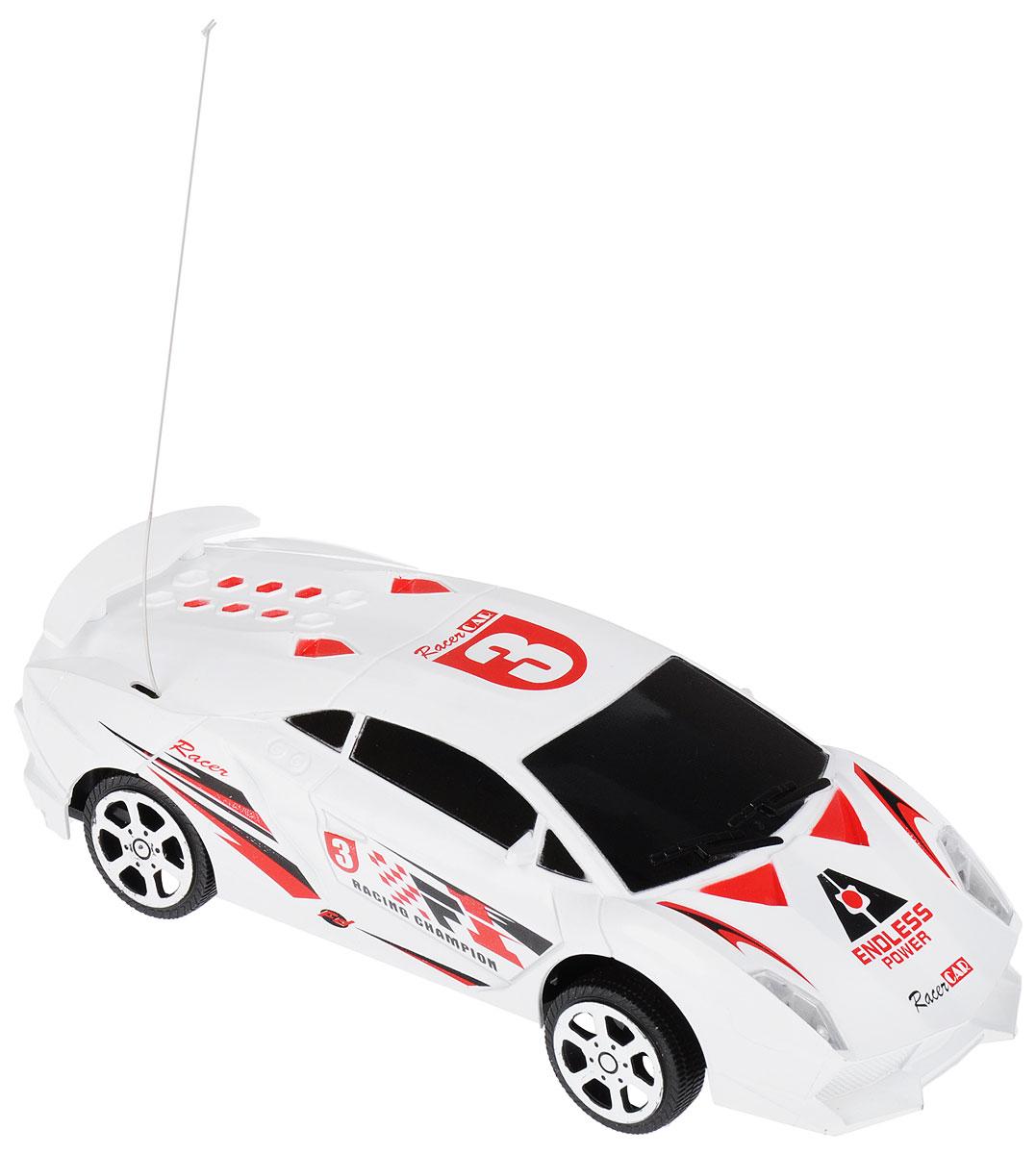 """Радиоуправляемая машинка """"Yako"""" понравится не только ребенку, но и взрослому, ценящему оригинальные подарки. Модель выполнена из прочного пластика. В комплект входит удобный пульт управления. Модель отличается тщательной проработкой и высокой детализацией. Автомобиль реалистично двигается вперед и совершает поворот. Прорезиненные колеса имеют рельеф и обеспечивают надежное сцепление с любой гладкой поверхностью. Реалистичная машинка на радиоуправлении приведет в восторг и ребенка, и взрослого, и принесет множество ярких впечатлений, а также позволит устроить настоящие гонки у себя дома.Для работы модели необходимо докупить 4 батарейки напряжением 1,5V типа АА (в комплект не входят).Для работы пульта необходимо докупить 2 батарейки напряжением 1,5V типа АА (в комплект не входят)."""