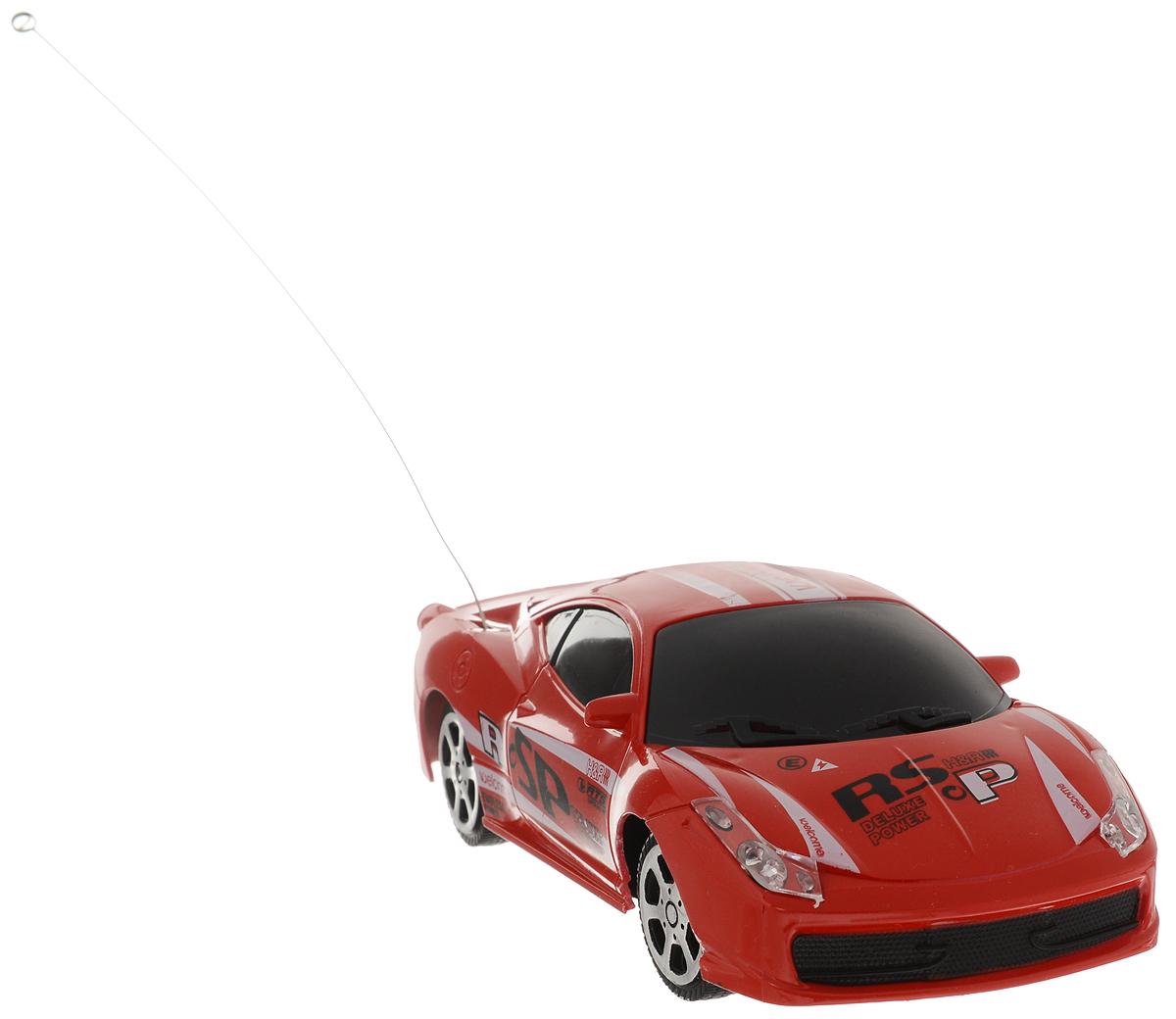 """Технологичная машинка на радиоуправлении Yako """"Racing Драйв"""" - это потрясающая гоночная модель, обладающая отличными характеристиками. В комплект также входит удобный пульт управления. Модель отличается тщательной проработкой и высокой детализацией. Автомобиль реалистично двигается вперед, а также выполняет повороты. Используемая частота - 27 МГц. Такая игрушка откроет новые просторы для фантазии маленького автолюбителя и поможет развить мелкую моторику рук, внимание, воображение и координацию движений.  Модель работает от 4 батарейки напряжением 1,5V типа АА (входят в комплект).Для работы пульта необходимо докупить 2 батарейки напряжением 1,5V типа АА (в комплект не входят)."""