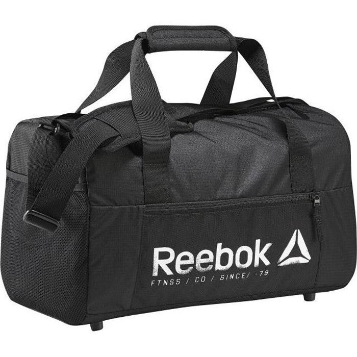 Сумка Reebok Found S Grip, цвет: черный. BK5989BM8434-58AEСумка Reebok Found S Grip,для тех, кто всегда в движении. В нее войдет экипировка для тренировки, а сама сумка легко поместится в шкафчик в раздевалке. Благодаря удобным ручкам и плечевому ремню ее можно взять и в зал на занятие, и в поездку за город на выходные.Материал: 100% полиэстер, легкий и в то же время прочный тканый материалРазмеры: 41 х 25 х 25 см, объем: 28 лПередний карман на молнии и внутренние отделения для удобной организации пространстваСетчатый карман снаружи для удобстваРучки с мягкими вставками для комфортной переноскиРегулируемый плечевой ремень с вставкой из ЭВАНебольшие ножки внизу