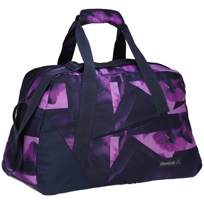 Сумка женская Reebok W Found Grip Graphi, цвет: черный, фиолетовый. BQ5451579995-400Положи в это сумку все, что может понадобиться в течение дня. Прочный материал не будет изнашиваться в течение долгого времени. Удобные ручки и ремень позволяют носить сумку на плече, через плечо или в руке.Материал: 100% полиэстер, легкий и в то же время прочный тканый материалРазмеры: 47 х 29 х 20 смСпециальный отсек для влажной одеждыРегулируемый плечевой ремень для удобстваКарман спереди, карман для бутылки с водой внутриДно из легкого в уходе материалаСтильный графический принт по всей поверхности