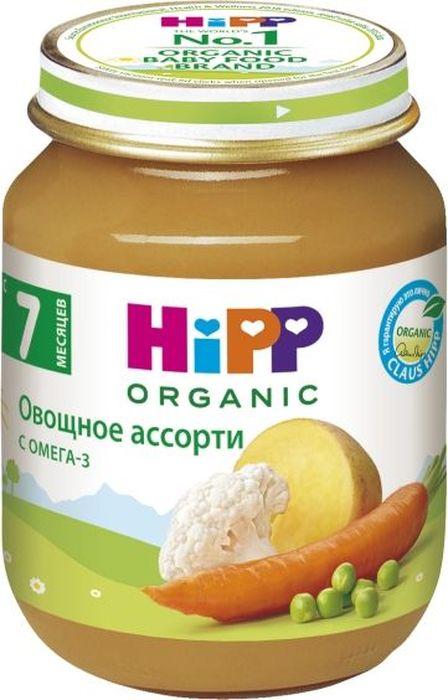 Hipp пюре овощное ассорти, с 7 месяцев, 125 г9062300100270Пюре Hipp Овощное ассорти - это пюре из моркови, картофеля, цветной капусты и гороха. Морковь - признанный лидер среди овощей по содержанию каротина. Каротин необходим для поддержания нормального зрения, состояния кожи, слизистых оболочек, для устойчивости организма к инфекциям дыхательных путей, укрепления иммунитета. В корнеплодах моркови содержатся соли кальция, фосфора, йода, железа, а также эфирные масла и фитонциды. Калий, содержащийся в моркови, регулирует водный обмен и оказывает противоотечное действие. Картофель содержит витамины В1, В2, В6 и С, калий, магний и железо. Он богат углеводами, а растущий ребенок нуждается в их большом количестве, как основном поставщике энергии. Белок картофеля очень хорошо усваивается организмом. Магний необходим для формирования костной ткани, нормализует возбудимость нервной системы, оказывает влияние на активность ряда ферментов, благотворно воздействует на работу детского желудка и кишечника. Цветная капуста благотворно воздействует на работу детского желудка и кишечника. Кроме того, в цветной капусте имеется повышенное содержание витаминов А, В1, В2, В6, РР. В головках капусты присутствуют калий, кальций, натрий, фосфор, железо, магний. Цветная капуста богата пектиновыми веществами, яблочной и лимонной кислотой, фолиевой и пантотеновой кислотой, солями фосфора, кальция и магния. Это пюре благотворно воздействует на работу детского желудка и кишечника. Горошек благотворно воздействует на работу детского желудка и кишечника.