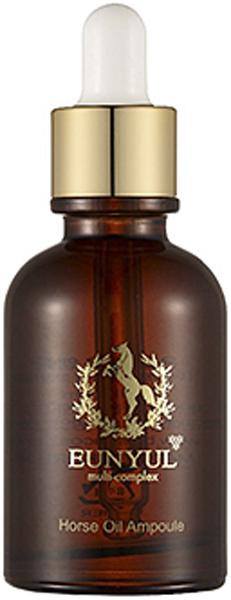 Eunyul Сыворотка с лошадиным маслом, 30 мл8809435401916Сыворотка – одно из самых высококонцентрированных косметических средств. Содержание активных компонентов, а также их способность проникать в самые глубокие слои кожи достигают максимума, а содержание различных консервантов, красителей и отдушек стремится к нулю. Все это делает сыворотки необычайно эффективными, позволяющими добиться видимых результатов в кратчайшие сроки. Ампульная сыворотка Multi-Complex Horse Oil Ampoule от Eunyul – это концентрат средства на основе лошадиного масла. Предназначена для глубокого питания, увлажнения и восстановления кожи. Подходит для любого типа кожи, но особенно рекомендуется для сухой, склонной к шелушению и увядающей кожи. Лошадиное масло – натуральный продукт, позволяющий справиться с различными проблемами кожи. Потеря упругости, сухость, шелушения, огрубевшие участки кожи – от всего этого спасёт сыворотка с лошадиным маслом. Также сыворотка эффективно защищает кожу от вредного воздействия окружающей среды, от обветривания и других негативных факторов. Состав лошадиного жира близок к человеческому жиру, поэтому он быстро впитывается и хорошо воспринимается кожей и оказывает на нее благоприятное воздействие. Может применяться для кожи любого типа: питает и увлажняет сухую, смягчает огрубевшую, успокаивает чувствительную, способствует заживлению акне проблемной кожи, омолаживает зрелую. Сразу при нанесении сыворотка увлажняет кожу, устраняет шелушения, питает и смягчает. При регулярном применении улучшает обмен веществ и значительно ускоряет процесс обновления клеток кожи. Оказывает стимулирующее действие на выработку коллагена, благодаря чему кожа становится более упругой и эластичной, разглаживаются морщины, осветляется пигментация. Сыворотка великолепно впитывается и не оставляет жирной пленки, может использоваться под макияж, а также добавляться в другие косметические средства.