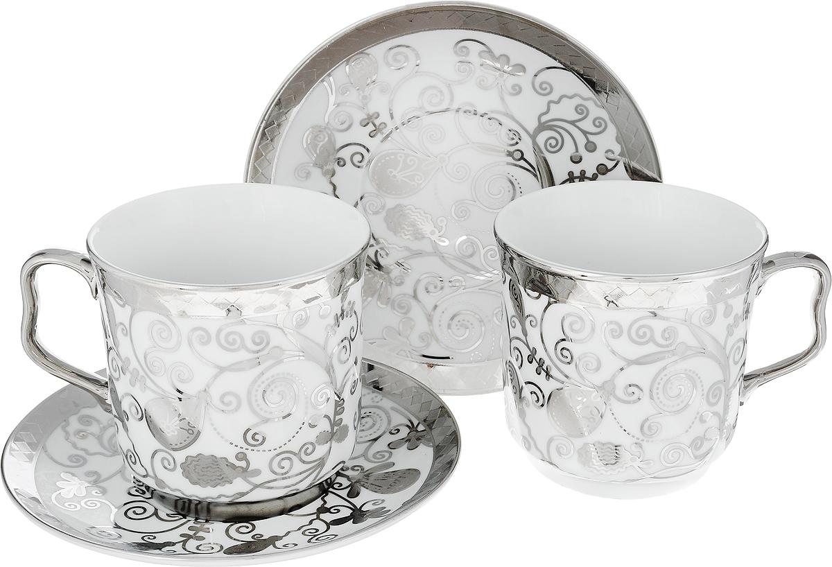 Сервиз чайный Bohmann, цвет: серебряный 4 предмета115610Чайный сервизBohmann станет незаменимым элементом среди коллекции вашей посуды. Ежедневное чаепитие в компании семьи или друзей ни с чем не сравнить. И тут не обойтись без красивой посуды, из которой приятно выпить ароматного чаю. Посуда выполнена из качественного белого фарфора, украшенного изящным узором. Изысканный дизайн чайной пары впишется как в торжественное, так и в повседневное оформление стола.В наборе две чашки объемом по 350 мл и два блюдца диаметром по 15,5 см. Фарфор не вступает в реакцию с напитком, поэтому никак не влияет на его вкус. Материал способен длительное время удерживать тепло, что позволяет растянуть удовольствие от чаепития. Диаметр блюдца: 15 смДиаметр чашки: 9 смВысота чашки: 9 см