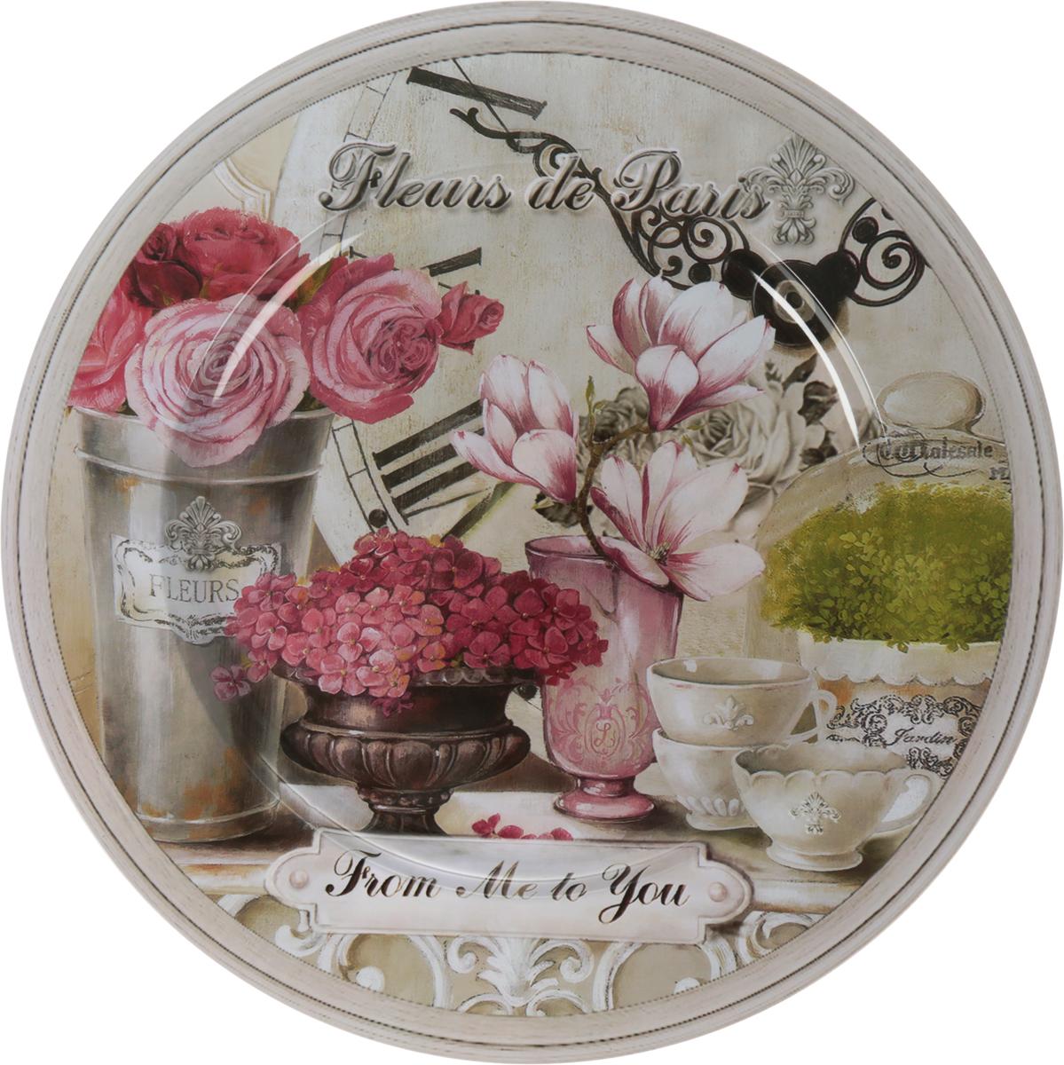 Поднос GiftnHome Парижские цветы, диаметр 33 см115610Поднос GiftnHome Парижские цветы изготовлен из жести и оформлен красочным цветочным рисунком в винтажном стиле. Декор выполнен в технике декупаж. Поднос может использоваться как для сервировки, так и для декора кухни. Поднос прекрасно дополнит интерьер и добавит в обычную обстановку нотки романтики и изящества. Диаметр: 33 см. Высота подноса: 1,5 см.