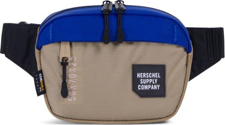Сумка поясная Herschel Tour Small, цвет: бежевый, синий, черный. 10321-01628-OS332515-2800Сделанная из легкого водонепроницаемого нейлона с усиленной основойCORDURA, эта сумка на пояс от Herschel представляет собой удобный и компактный профиль, который можно носить как на поясе, так и через плечо. Объем в 1 литр на первый взгляд может показаться небольшим, но на самом деле его с запасом хватит для всех нужных аксессуаров.
