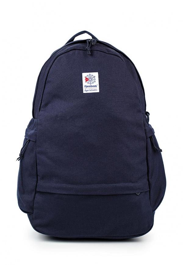 Рюкзак Reebok Cl Fo Jwf Backpack, цвет: темно-синий. BP814023008Говорят, этот стильный рюкзак – все, что нужно для переноски спортивной экипировки или школьных принадлежностей. Во внешний карман поместятся телефон и солнечные очки, а в основном отделении достаточно места для ноутбука и обуви.Материал: хлопок, холщовый материал для прочности и износостойкостиРазмеры: 29 х 48 х 14 см, объем: 21 лВнешний карман и основное отделение на молнии для надежного хранения вещейУсиленное внутреннее отделение для безопасного хранения ноутбукаБольшие боковые карманы для всего необходимогоУдобные регулируемые лямкиДополнительное отделение для обуви