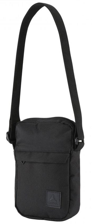 Сумка на пояс Reebok Style Found City Ba, цвет: черный. CD21841696035Положи в эту сумку то, что понадобится в течение дня. В нее поместятся телефон, бумажник, ключи и карточки. Регулируемый ремешок для удобства.Материал: 100% полиэстер, легкий и в то же время прочный тканый материалРазмеры: 22 х 14 х 4 смПередний карман на молнии для надежностиРегулируемый плечевой ремень для удобстваСтильный принт спередиДополнительный карман сзади