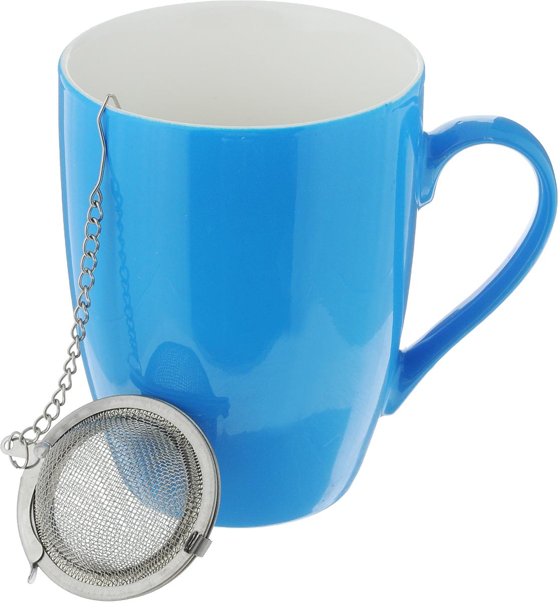 Кружка Доляна Радуга, с ситечком, цвет: голубой, 300 мл699261_голубойКружка Доляна Радуга изготовлена из высококачественной керамики. Изделие оформлено ярким дизайном и покрыто превосходной сверкающей глазурью. Изысканная кружка прекрасно оформит стол к чаепитию и станет его неизменным атрибутом.В комплект входит ситечко для заварки.Диаметр кружки (по верхнему краю): 8 см.Высота кружки: 10,5 см.Диаметр ситечка: 4,5 см.