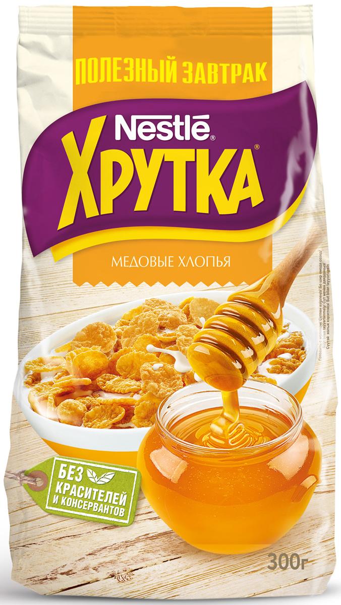 Nestle Хрутка Медовые хлопья готовый завтрак, 300 г12131733Готовый завтрак Nestle Хрутка - это именно то, что вам нужно! Добавьте молоко, йогурт, кефир или сок - и ваше утро начнется с вкусного разнообразного завтрака. Кукурузные хлопья Хрутка производятся по высоким стандартам качества Nestle из кукурузы, выращенной в России. Кукурузные зерна тщательно отбираются, затем очищаются и подвергаются бережной обработке. Благодаря специальной технологии приготовления, хлопья получаются вкусными и полезными.