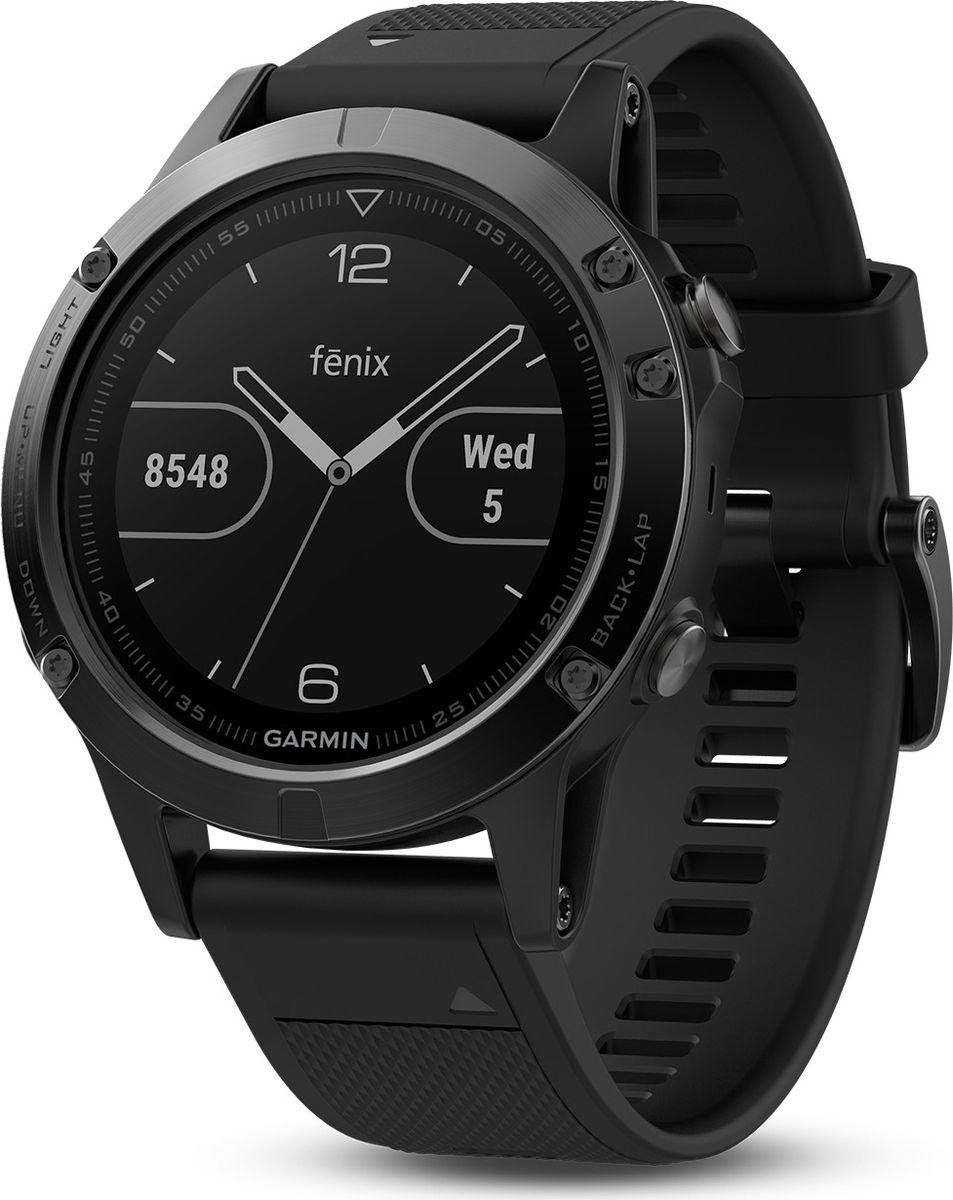 Часы спортивные Garmin Fenix 5, цвет: серый. 010-01688-00010-01688-00Часы с GPS/ГЛОНАСС для повседневной жизни, приключений, фитнеса и спортаFenix 5 серые часы с черным ремешкомПремиум-часы с GPS/ГЛОНАСС, мультиспортивными тренировками и встроенным оптическим пульсометром Elevate1Созданы для активных приключений: прочный корпус со стальным безелем, кнопками и задней крышкой, защита от воды 100мВиджеты, которые показывают эффективность ход тренировок доступны одним касаниемСмарт функции2 - интеллектуальные оповещения, автоматическая загрузка в интернет-сообщество Garmin Connect и персонализация через загружаемые бесплатные циферблаты и приложения из магазина Connect IQВстроенные датчики: GPS и ГЛОНАСС, 3-х осевой магнитный компас, гироскоп, термометр, барометр и барометрический высотомерСрок работы от батареи: до двух недель в режиме умных часов (зависит от настроек), до 24 часов в режиме тренировки с GPS или до 60 часов в режиме экономии UltraTracСовершенствуйтесь весь день, каждый день. Fenix 5 - это высококачественные умные GPS-часы с мультиспортом, интеллектуальными уведомлениями2 и встроенным оптическим пульсометром на запястье1. Улучшенные функции фитнеса и быстросменные ремешки, которые позволяют вам уйти с рабочего места на тренировку, без задержек. Каким бы видом спорта вы не занимались, Fenix 5 его поддерживает, благодаря встроенным профилям деятельности и показателям производительности.Две системы навигацииFenix 5 оснащен улучшенным спутниковым приемником GPS и ГЛОНАСС для отслеживания местоположения в сложных условиях. Вы можете рассчитывать на длительное время автономной работы в каждом режиме работы (конкретное время зависит от модификации часов и настроек). Защита от воды 100м позволит вам с уверенностью путешествовать везде, где захочется.Отличная читаемость на ходуЯркий полноцветный дисплей Garmin Chroma Display со светодиодной подсветкой обеспечивает отличную читаемость при любых внешних условиях. Трансфлективная технология, которая одновременно отр