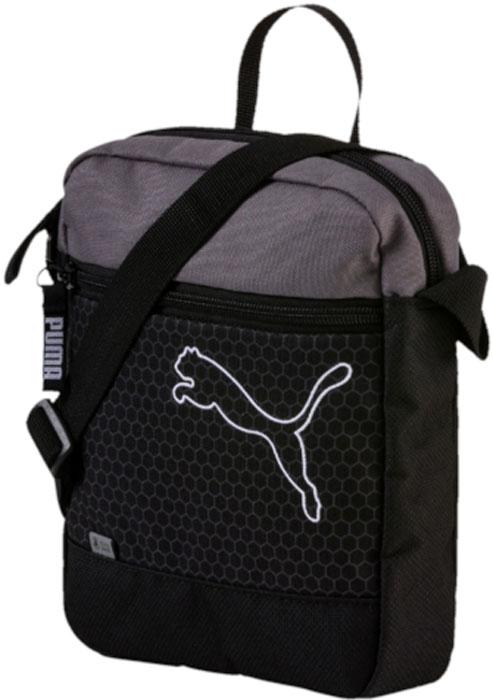 Сумка на плечо Puma Echo Portable, цвет: черный, 3 л. 0743980107439801Удобная и вместительная сумка-рюкзак имеет главное отделение на молнии, карман спереди на молнии, функциональную подкладку из полиэстера с изнанкой из полиуретана, лямку через плечо из плотной тесьмы регулируемой длины, ручку для переноски из лямочной ленты. В язычок застежки-молнии главного отделения продернута плотная тесьма, а непосредственно на металлический язычок застежки-молнии кармана спереди нанесена фирменная символика PUMA. Кроме того, сумка декорирована спереди крупным вышитым логотипом PUMA и тесьмой Durabase из светоотражающего материала.