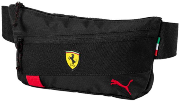 Сумка поясная Puma Ferrari Fanwear Waist Bag, цвет: черный, 1 л. 0747780207477802Поясная сумочка имеет главное отделение на молнии, карман спереди на молнии, карман на молнии с подкладкой внутри и поясной ремень из плотной тесьмы с пряжкой, снабженной логотипом PUMA. Также сумочка частично закрывается клапаном с символикой гоночной команды Ferrari. В металлические язычки застежек-молний продернута плотная тесьма. Символика PUMA и Ferrari также представлена в виде силиконовой эмблемы Ferrari и вышитого логотипа Puma спереди.