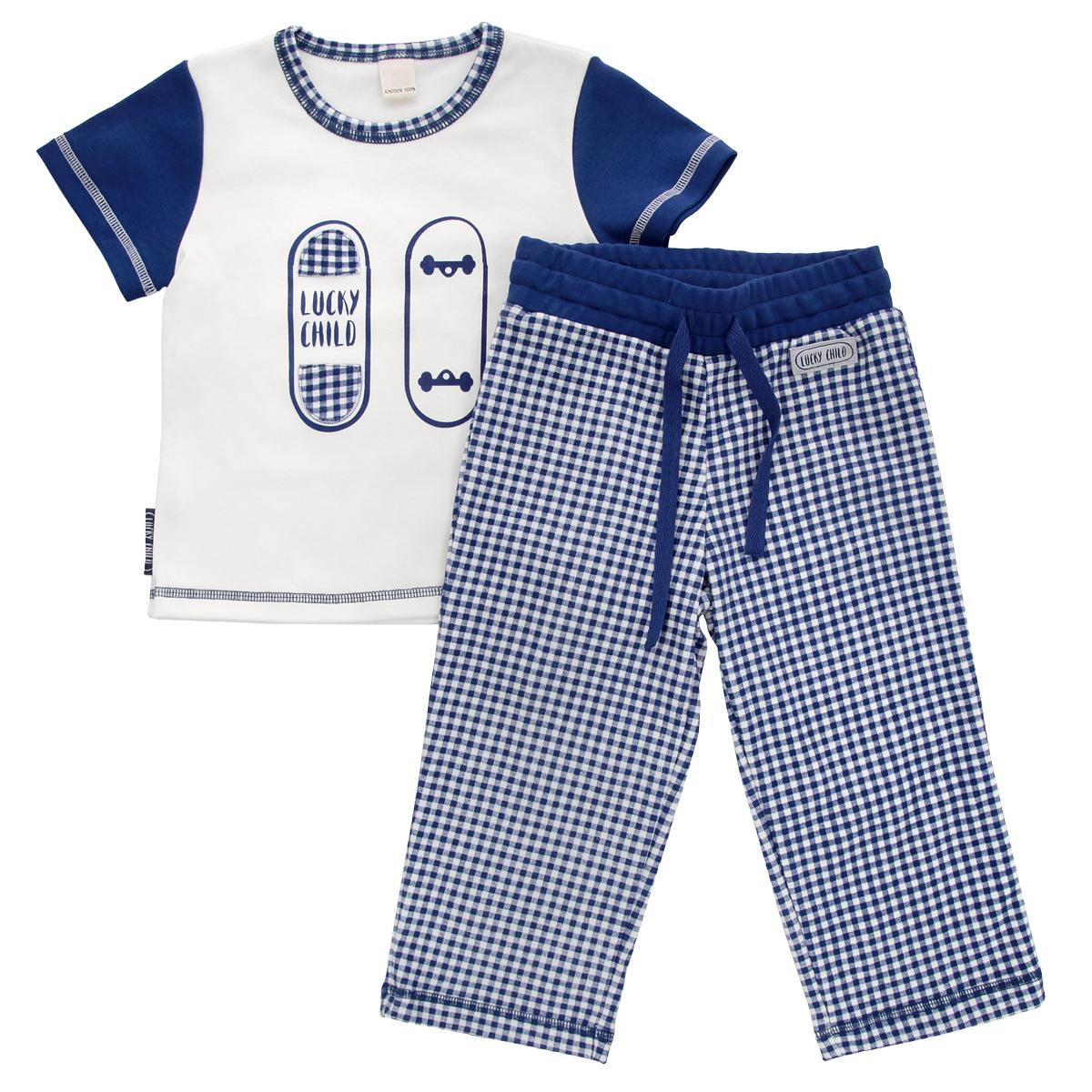 Пижама для мальчика Lucky Child, цвет: синий, молочный. 13-403. Размер 104/11013-403Очаровательная пижама для мальчика Lucky Child, состоящая из футболки и брюк, идеально подойдет вашему маленькому мужчине и станет отличным дополнением к детскому гардеробу. Изготовленная из натурального хлопка - интерлока, она необычайно мягкая и приятная на ощупь, не раздражает нежную кожу ребенка и хорошо вентилируется, а эластичные швы приятны телу и не препятствуют его движениям.Футболка с короткими рукавами и круглым вырезом горловины оформлена спереди оригинальной аппликацией и принтом с изображением скейтборда. Горловина оформлена принтом в клетку. Низ рукавов и низ изделия оформлены контрастной фигурной прострочкой. Брюки на талии имеют широкий эластичный пояс со шнурком, благодаря чему они не сдавливают животик ребенка и не сползают. Оформлены брюки принтом в клетку и небольшой нашивкой с названием бренда. Такая пижама идеально подойдет вашему ребенку, а мягкие полотна позволят ему комфортно чувствовать себя во время сна!