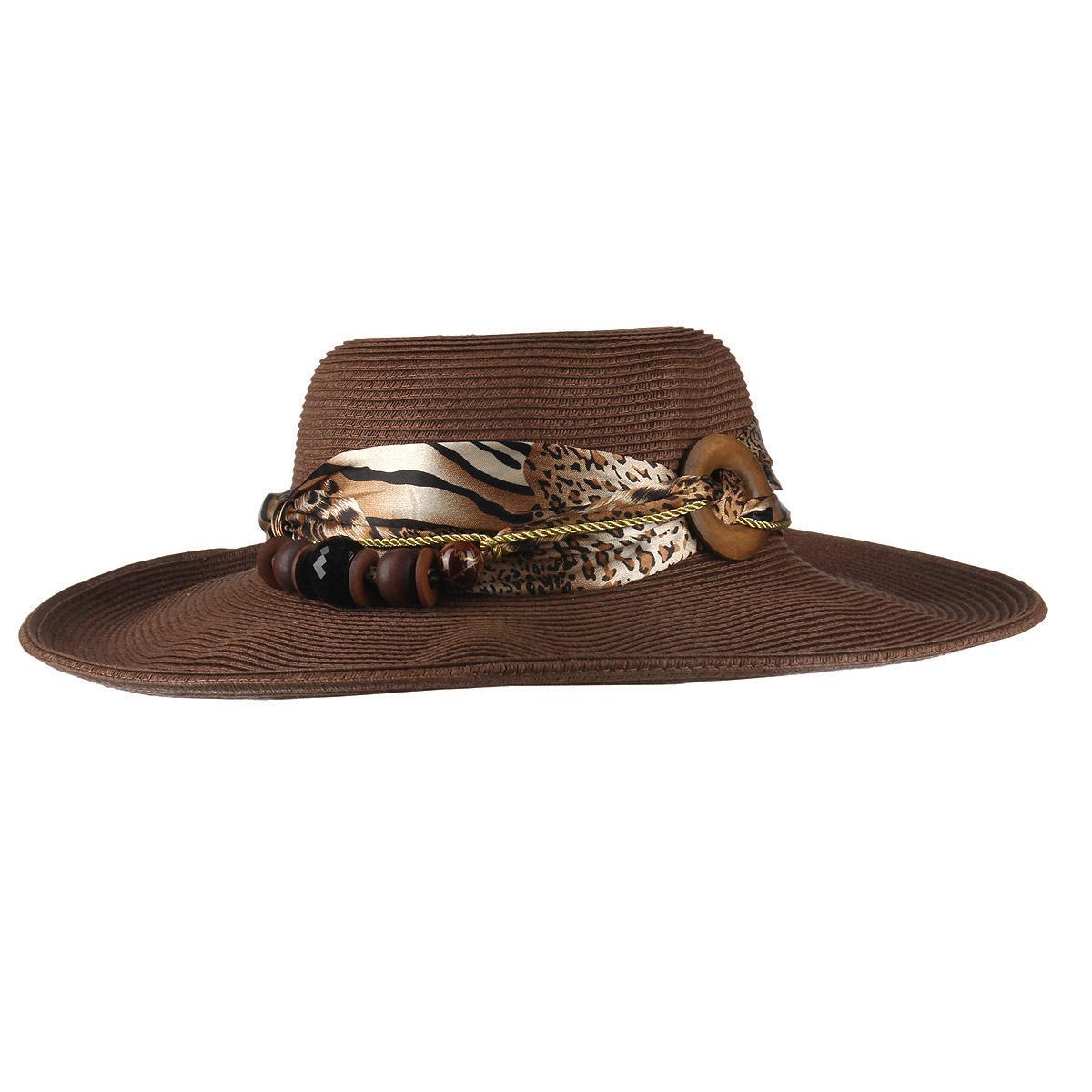 Шляпа женская Canoe Yanda, цвет: коричневый. 1966159. Размер 561966159Летняя женская шляпа Canoe Yanda, выполненная из искусственной соломы и полиэстера, станет незаменимым аксессуаром для пляжа и отдыха на природе. Широкие поля шляпы надежно защищают от солнечных лучей.Шляпа оформлена стильной лентой и оригинальным плетеным шнурком вокруг тульи, украшенным разнообразными крупными бусинами. Плетение шляпы обеспечивает необходимую вентиляцию и комфорт даже в самый знойный день. Шляпа легко восстанавливает свою форму после сжатия.Стильная шляпа с элегантными волнистыми полями подчеркнет вашу неповторимость и дополнит ваш повседневный образ.