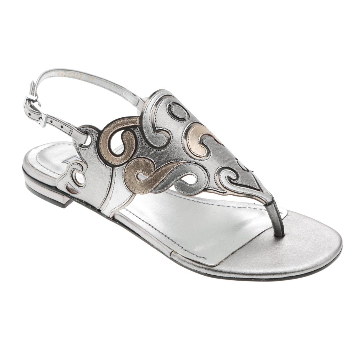 Сандалии женские Werner, цвет: серебряный. 1-23312. Размер 33 (34)1-23312Стильные сандалии от Werner займут достойное место среди вашей коллекции летней обуви. Модель выполнена из натуральной кожи и декорирована на подъеме оригинальным узором. Эргономичная перемычка между пальцами и ремешок, огибающий пятку, с прямоугольной металлической пряжкой отвечают за надежную фиксацию модели на ноге. Стелька из натуральной кожи обеспечивает комфорт при ходьбе. Подошва выполнена из прочного полимера с противоскользящим рифлением.Модные сандалии прекрасно дополнят любой из ваших образов.