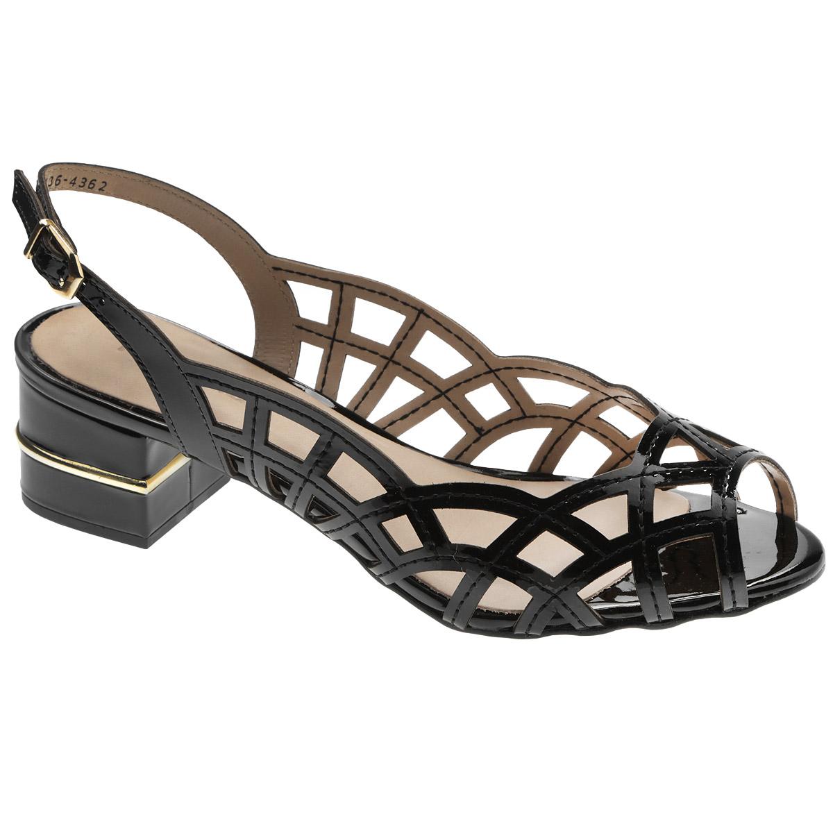 Босоножки Miucha, цвет: черный. 436-4362. Размер BRA 34 (35)436-4362Стильные босоножки от Miucha займут достойное место среди вашей коллекции летней обуви. Модель выполнена из натуральной лакированной кожи и оформлена крупной перфорацией. Открытый носок и задник обеспечивают дополнительную вентиляцию, позволяют ногам дышать. Ремешок с металлической пряжкой оригинальной формы отвечает за надежную фиксацию модели на ноге. Длина ремешка регулируется за счет болта. Стелька из натуральной кожи гарантирует комфорт при ходьбе. Средняя часть каблука декорирована по контуру золотистой пластиной. Рифление на каблуке и на подошве защищает изделие от скольжения.Прелестные босоножки очаруют вас своим дизайном с первого взгляда.
