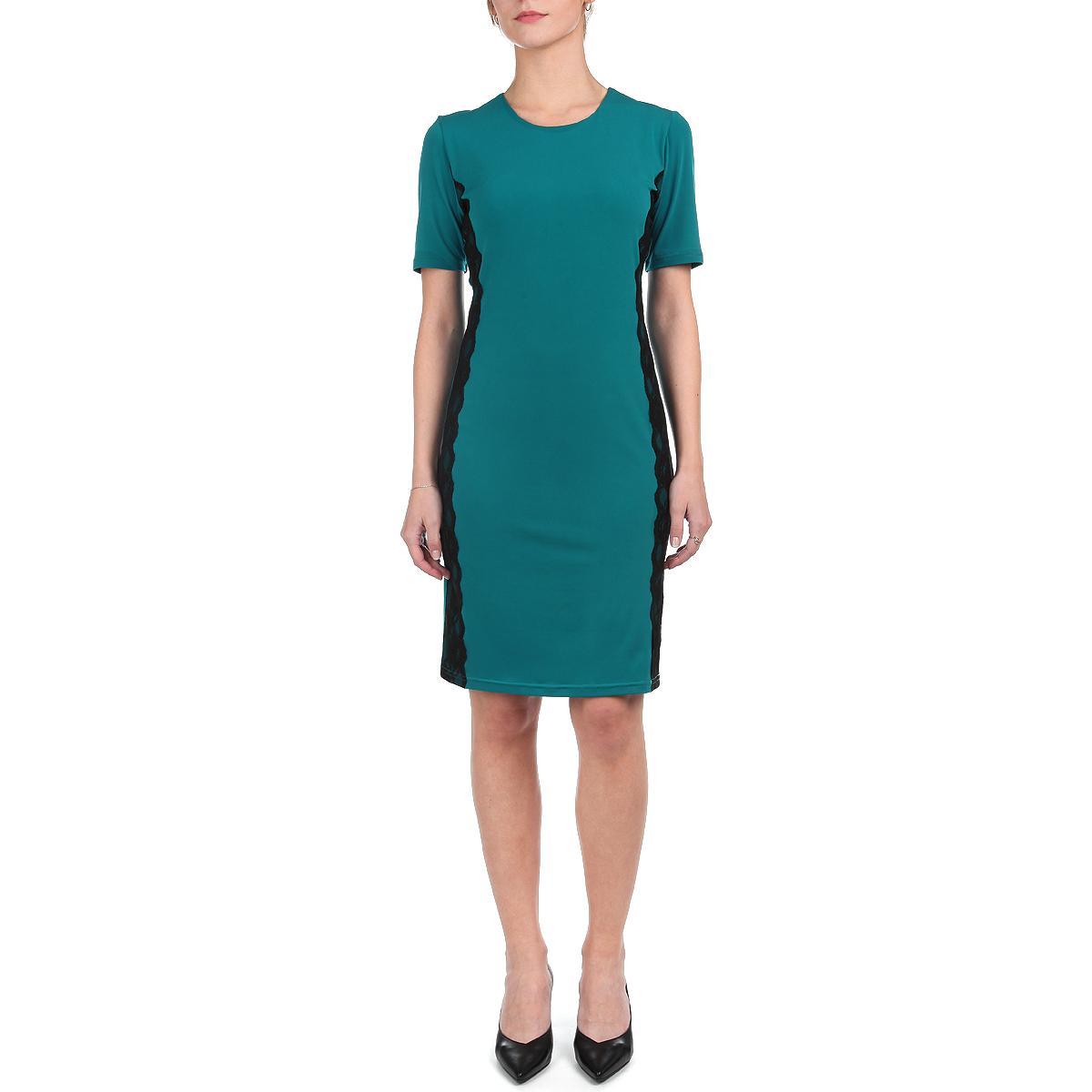 Платье Lautus, цвет: темно-бирюзовый, черный. 605. Размер 48605Элегантное платье Lautus выполнено из мягкого эластичного материала. Модель с короткими рукавами и круглым вырезом горловины подарит вам ощущение комфорта и уверенности. Облегающий крой и классическая длина до колена выгодно подчеркнут достоинства фигуры. Модель по бокам декорирована контрастными кружевными вставками. Модное платье - идеальный вариант для создания эффектного образа.