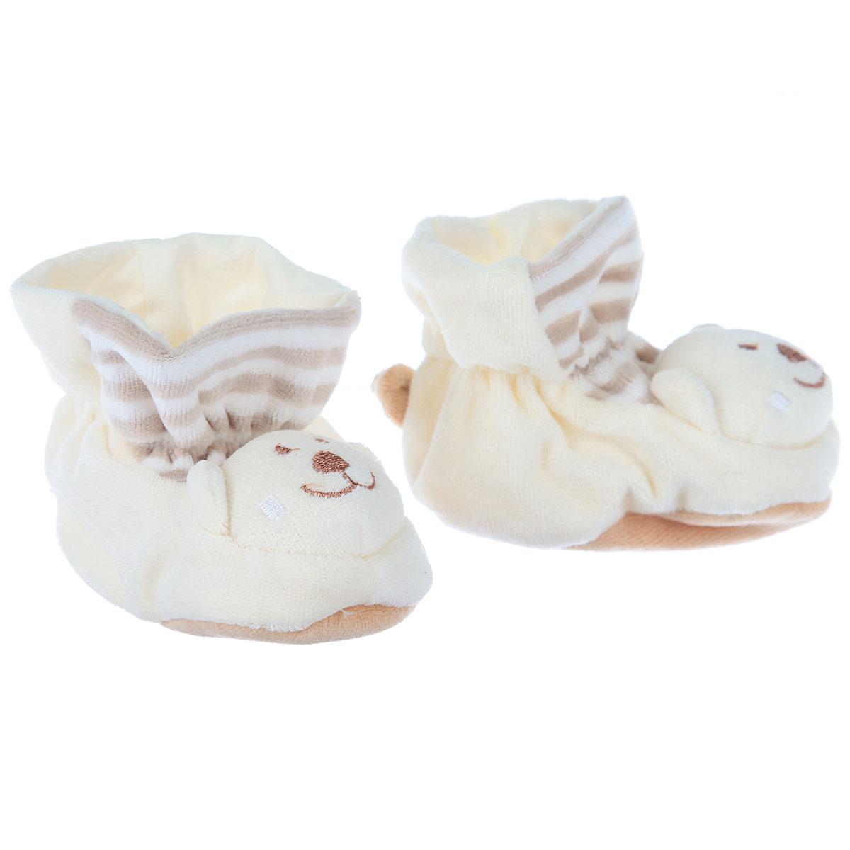 Пинетки Baby Nice Мишки, цвет: бежевый. Р47061. Возраст 0месР47061Очаровательные пинетки Baby Nice Мишки идеально подойдут для маленьких ножек вашего крохи! Они очень нежные и приятные на ощупь, не раздражают кожу и хорошо вентилируются. В хлопковых велюровых пинетках ножка малыша дышит и не мерзнет - созданы все комфортные условия, для того, чтобы подумать о первых шагах!Пинетки изготовлены из очень мягкого и приятного на ощупь ворсистого материала - 100% хлопка и оформлены объемной головой в виде медвежонка. Благодаря скрытой эластичной резинке пинетки будут отлично держаться на ножке младенца. Подошва выполнена в контрастном цвете. Такие пинетки - отличное решение для малышей и их родителей!