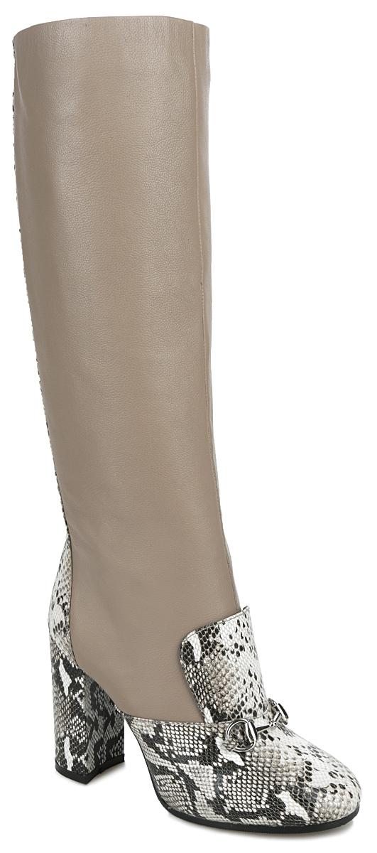 Сапоги женские Vitacci, цвет: темно-бежевый, белый, черный. 47086. Размер 4047086Стильные женские сапоги от Vitacci не оставят равнодушной настоящую модницу! Модель изготовлена из натуральной кожи. Внутренняя часть и стелька - из ворсина, защитят ноги от холода и обеспечат комфорт. На мысе и подъеме сапоги дополнены декоративными вставками из кожи с тиснением под рептилию и небольшим декоративным металлическим элементом под серебро. Задняя часть изделия и каблук также дополнены декоративными вставками из кожи с тиснением под рептилию и декоративной металлической молнией. Высокий каблук устойчив. Сапоги застегиваются на застежку-молнию, расположенную на одной из боковых сторон. Подошва из термополиуретана с рельефным протектором обеспечивает отличное сцепление на любой поверхности. Каблук, стилизованный под дерево, устойчив. Модные сапоги покорят вас своим оригинальным дизайном и удобством!