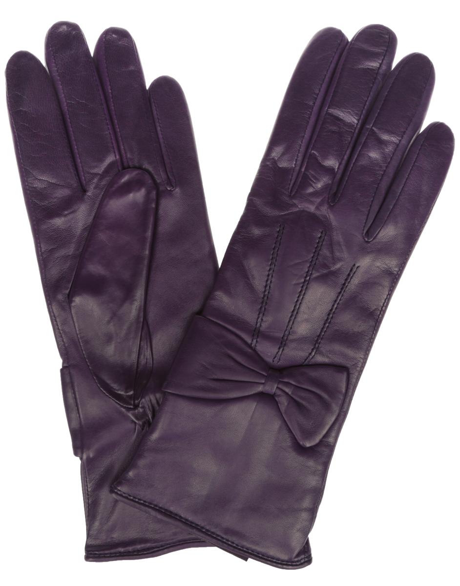 Перчатки женские Eleganzza, цвет: фиолетовый. IS456. Размер 6,5IS456Элегантные женские перчатки Eleganzza станут великолепным дополнением вашего образа и защитят ваши руки от холода и ветра во время прогулок.Перчатки выполнены из натуральной кожи и имеют подкладку из шерстяной пряжи, что позволяет им надежно сохранять тепло и обеспечивает высокую гигроскопичность. Перчатки оформлены декоративными строчками на тыльной стороне и кожаными бантами на запястьях. Такие перчатки будут оригинальным завершающим штрихом в создании современного модного образа, они подчеркнут ваш изысканный вкус и станут незаменимым и практичным аксессуаром.