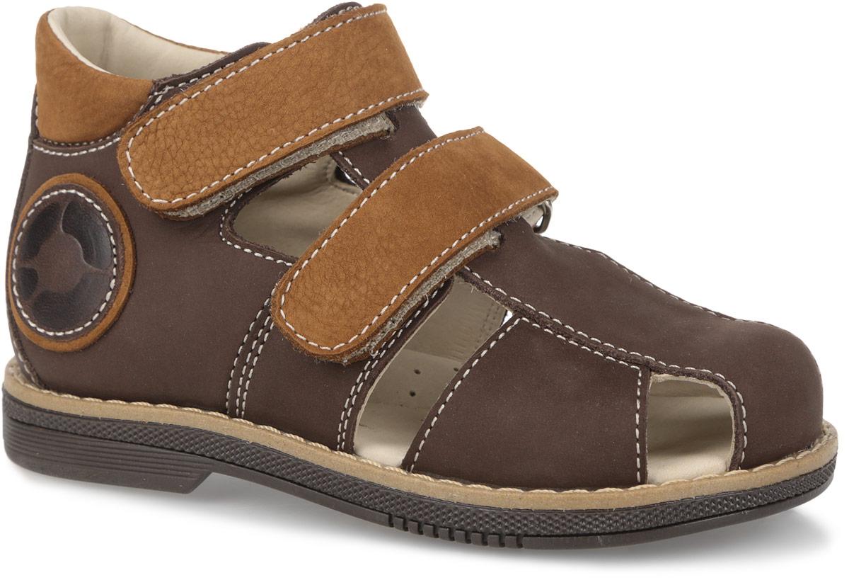 Сандалии для мальчика TapiBoo, цвет: коричневый. FT-26004.15-OL13O.01. Размер 28FT-26004.15-OL13O.01Модные сандалии от TapiBoo придутся по душе вам и вашему мальчику!Модель выполнена из натурального нубука со вставками из натуральной кожи. Обувь оформлена крупной прострочкой вдоль ранта, сбоку - аппликацией в виде логотипа бренда, на подошве сзади - названием бренда. Отсутствие швов на подкладке гарантирует дополнительный комфорт и предотвращает натирание. Полужесткий закрытый задник и ремешки на застежках-липучках надежно фиксируют ножку ребенка, не давая ей смещаться из стороны в сторону и назад. Стелька из натуральной кожи дополнена супинатором с перфорацией, который обеспечивает правильное положение ноги ребенка при ходьбе, предотвращает плоскостопие. Ортопедический каблук Томаса укрепляет подошву под средней частью стопы и препятствует заваливанию детской стопы внутрь. Упругая подошва дополнена перекатами, позволяющими повторить естественное движение стопы при ходьбе для правильного распределения нагрузки на опорно-двигательный аппарат.Удобные и стильные сандалии - необходимая вещь в гардеробе каждого мальчика!