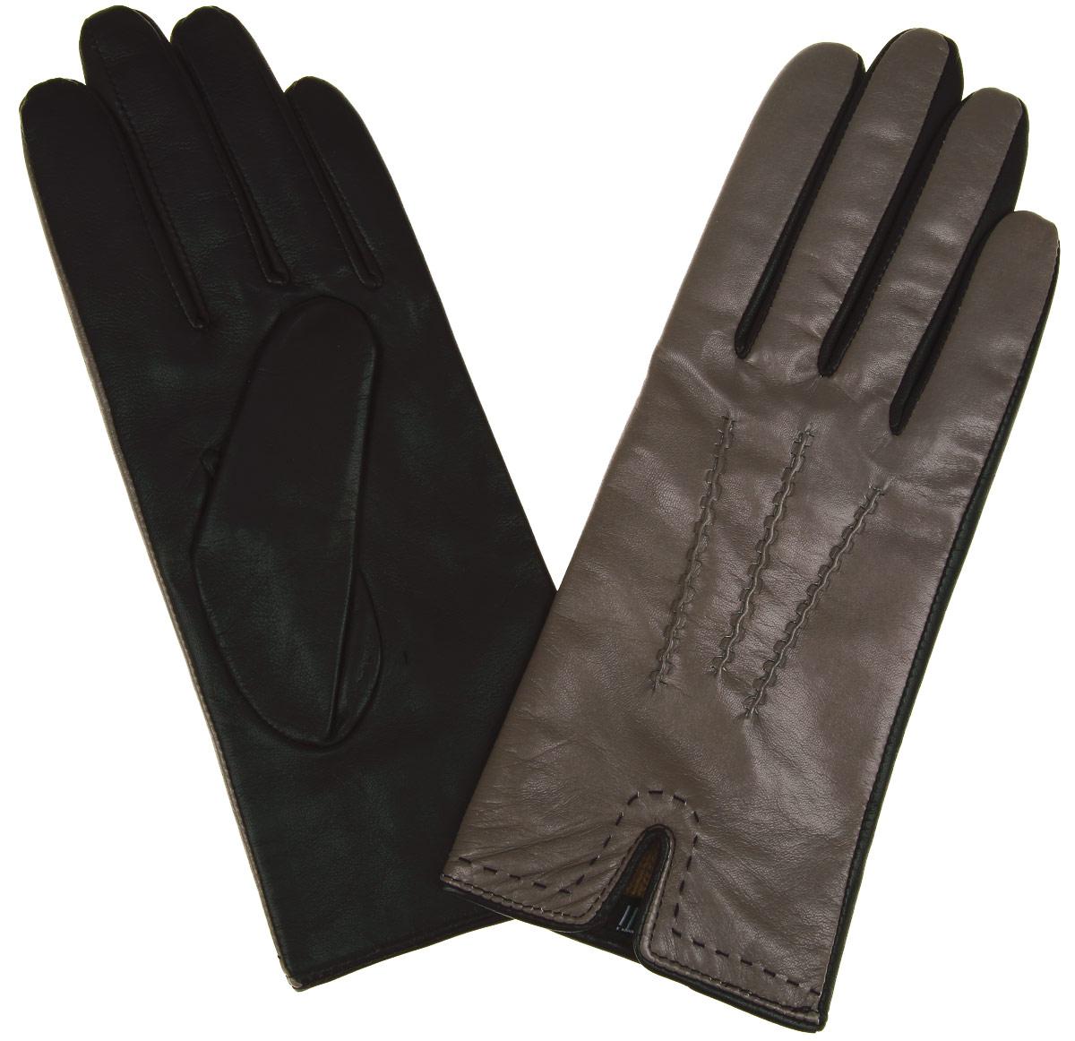 Перчатки женские Fabretti, цвет: серо-коричневый, темно-коричневый. 2.27-10. Размер 7,52.27-10Элегантные женские перчатки Fabretti станут великолепным дополнением вашего образа и защитят ваши руки от холода и ветра во время прогулок.Перчатки выполнены из эфиопской перчаточной кожи ягненка на подкладке из шерсти с добавлением кашемира, что позволяет им надежно сохранять тепло. Манжеты с внешней стороны дополнены разрезами. Модель оформлена декоративной прострочкой. Такие перчатки будут оригинальным завершающим штрихом в создании современного модного образа, они подчеркнут ваш изысканный вкус и станут незаменимым и практичным аксессуаром.