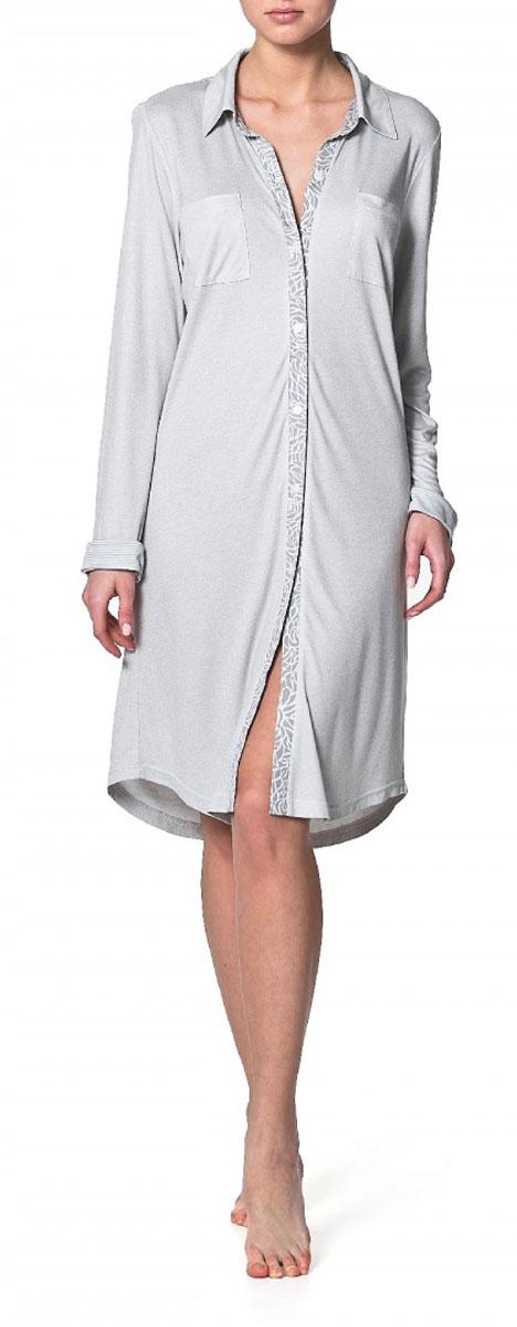 Платье-рубашка Ardi, цвет: серый меланж. R1550-47. Размер 42 (48)R1550-47Домашнее платье–рубашка Ardi, выполненное из вискозы с модалом, прекрасная альтернатива домашнему халату. Модель с отложным воротником, длинными рукавами и манжетами, спереди застегивается на пластиковые пуговицы по всей длине. На спинке модели плечевая кокетка в полоску. Спереди расположенынагрудные накладные карманы. Низ изделия - фигурный закругленный. Это оригинальное платье-рубашка станет отличным дополнением вашего гардероба!