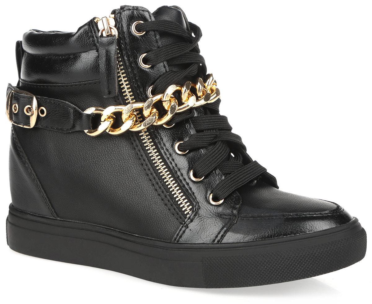 Сникеры женские Burlesque, цвет: черный. 5128-40. Размер 395128-40/BLACKОригинальные женские сникерсы Burlesque заинтересуют вас своим дизайном. Модель выполнена из искусственной кожи. Верх изделия оформлен шнуровкой, которая надежно зафиксирует обувь на ноге и отрегулирует объем. Сбоку сникерсы дополнены функциональной металлической молнией. Подкладка, изготовленная из текстиля, и стелька - из ЭВА материала с покрытием из искусственной кожи, обеспечат ногам уют. Верх голенища по канту оформлен горизонтальной строчкой и декоративным ремешком со стильной фурнитурой в виде широкой цепи и пряжки с покрытием под золото. Задник дополнен ярлычком для более удобного надевания обуви. Танкетка умеренной высоты - устойчива. Подошва из полимерного термопластичного материала с рельефным протектором обеспечивает отличное сцепление с любой поверхностью. В этих сникерсах вашим ногам будет комфортно и уютно. Они подчеркнут ваш стиль и индивидуальность.