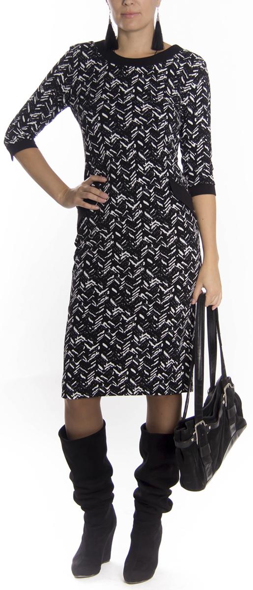 Платье Lautus, цвет: черный, белый. 654. Размер 48654Стильное платье Lautus приталенного силуэта из мягкого плотного трикотажа подойдет для повседневной носки. Модель выполнена из полиэстера, вискозы и лайкры, благодаря которым изделие хорошо держит форму. Яркое платье с круглым вырезом горловины и рукавами 3/4 застегивается по спинке на молнию.Это модное платье станет отличным дополнением к вашему гардеробу.
