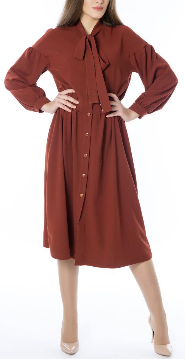 Платье Lautus, цвет: терракотовый. 666. Размер 52666Стильное женское платье Lautus, выполненное из высококачественных материалов, идеально впишется в ваш гардероб. Модель с изящным воротником и длинными рукавами застегивается на пуговицы по всей длине. Оригинальный крой изделия подчеркнет достоинства вашей фигуры.. Манжеты рукавов модели дополнены клястиками на пуговицах. Это яркое платье с оригинальным принтом станет отличным дополнением к вашему гардеробу.