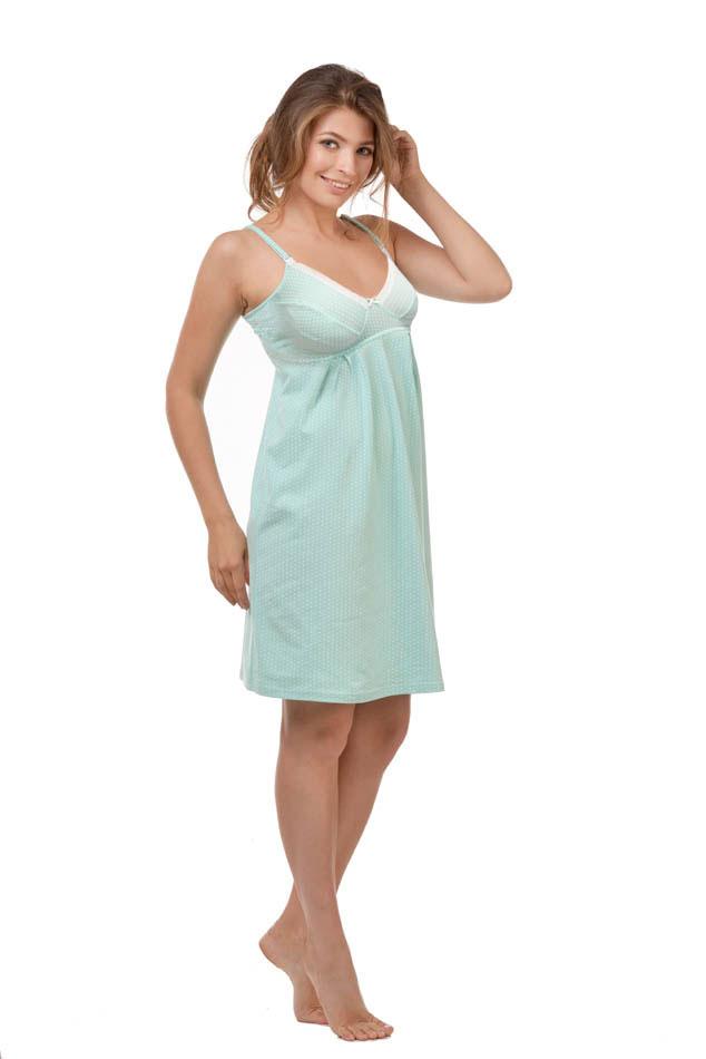 Сорочка ночная для беременных и кормящих Мамин Дом Mojito, цвет: мятный. 24127. Размер 4824127Удобная, красивая ночная сорочка для беременных и кормящих мам Мамин Дом, изготовленная из натурального хлопка с добавлением эластана, женственна и элегантна. Модель на тонких бретелях оформлена очаровательным принтом в мелкий горох, а чашечки украшены кружевной вставкой. Бретельки регулируются по длине. Чашки сорочки легко отстегиваются, благодаря пластиковым клипсам, что позволяет в любой момент быстро и легко покормить малыша. Свободный крой позволяет носить ночную сорочку как во время беременности, так и после родов. Такая сорочка сделает отдых будущей мамы комфортным. Одежда, изготовленная из хлопка, приятна к телу, сохраняет тепло в холодное время года и дарит прохладу в теплое, позволяет коже дышать.