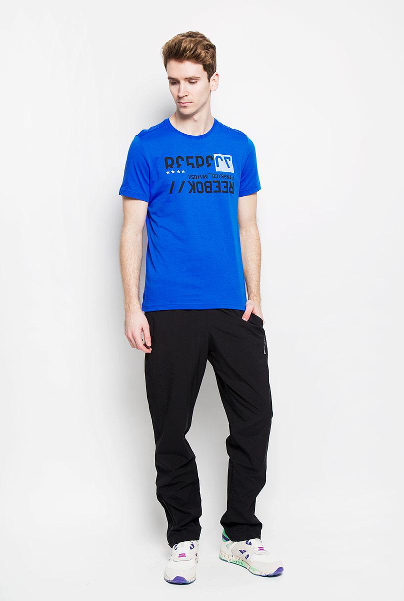 Футболка мужская Reebok Woe C Com, цвет: синий. AK1477. Размер S (44/46)AK1477Стильная мужская футболка Reebok Wor C Com, выполненная из хлопка и полиэстера, обеспечивает наибольший комфорт и свободу движений во время занятий спортом и в повседневной носке. Модель свободного кроя с круглым вырезом горловины и короткими рукавамиподарит вам удобство и комфорт. Изделие имеет смещенные плечевые швы, кокетку на спинке. Спереди расположен оригинальный принт в виде надписей на английском языке. Такая футболка послужит замечательным дополнением к вашему гардеробу.