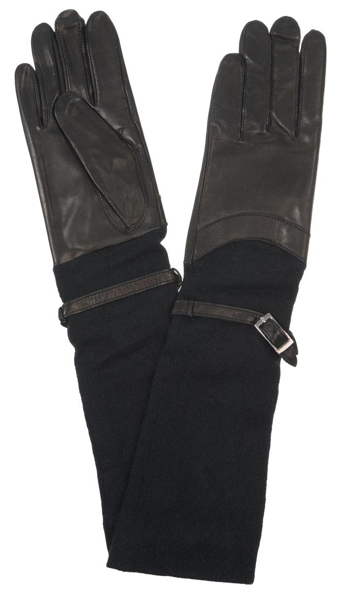 Перчатки женские Eleganzza, цвет: черный. HP00174. Размер 6HP00174Элегантные удлиненные женские перчатки Eleganzza станут великолепным дополнением вашего образа и защитят ваши руки от холода и ветра во время прогулок.Перчатки выполнены из натуральной кожи ягненка. Модель дополнена длинными трикотажными манжетами с декоративным ремешком.Такие перчатки будут оригинальным завершающим штрихом в создании современного модного образа, они подчеркнут ваш изысканный вкус и станут незаменимым и практичным аксессуаром.