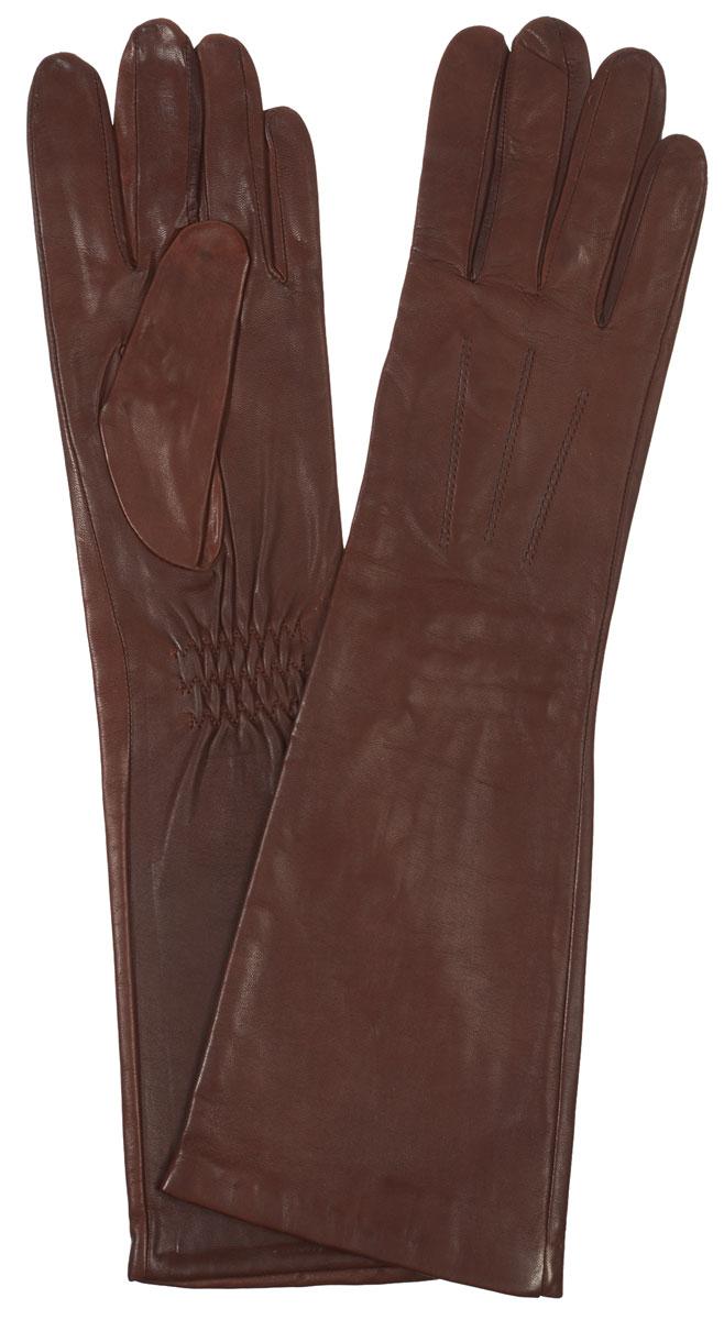 Перчатки женские Eleganzza, цвет: коричневый. IS598. Размер 7IS598Элегантные удлиненные женские перчатки Eleganzza станут великолепным дополнением вашего образа и защитят ваши руки от холода и ветра во время прогулок.Перчатки выполнены из натуральной кожи ягненка. На внешней стороне - шов 3 луча. Тыльная сторона дополнена резинкой для оптимальной посадки модели на руке. Такие перчатки будут оригинальным завершающим штрихом в создании современного модного образа, они подчеркнут ваш изысканный вкус и станут незаменимым и практичным аксессуаром.